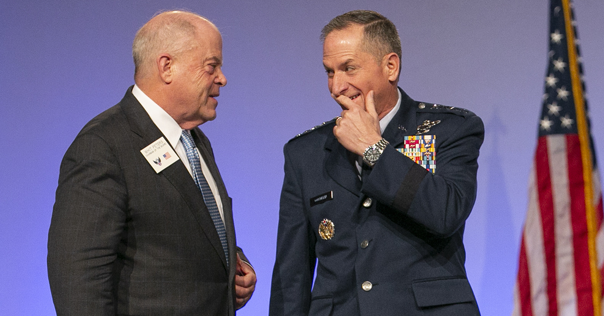 Whit Peters, Chairman of the AFA Board, talks with Air Force Chief of Staff, Gen. David Goldfein during the opening day of the Air Force Association's Air, Space & Cyber conference held at the Gaylord National Resort & Conference Center in Oxon Hill, MD.