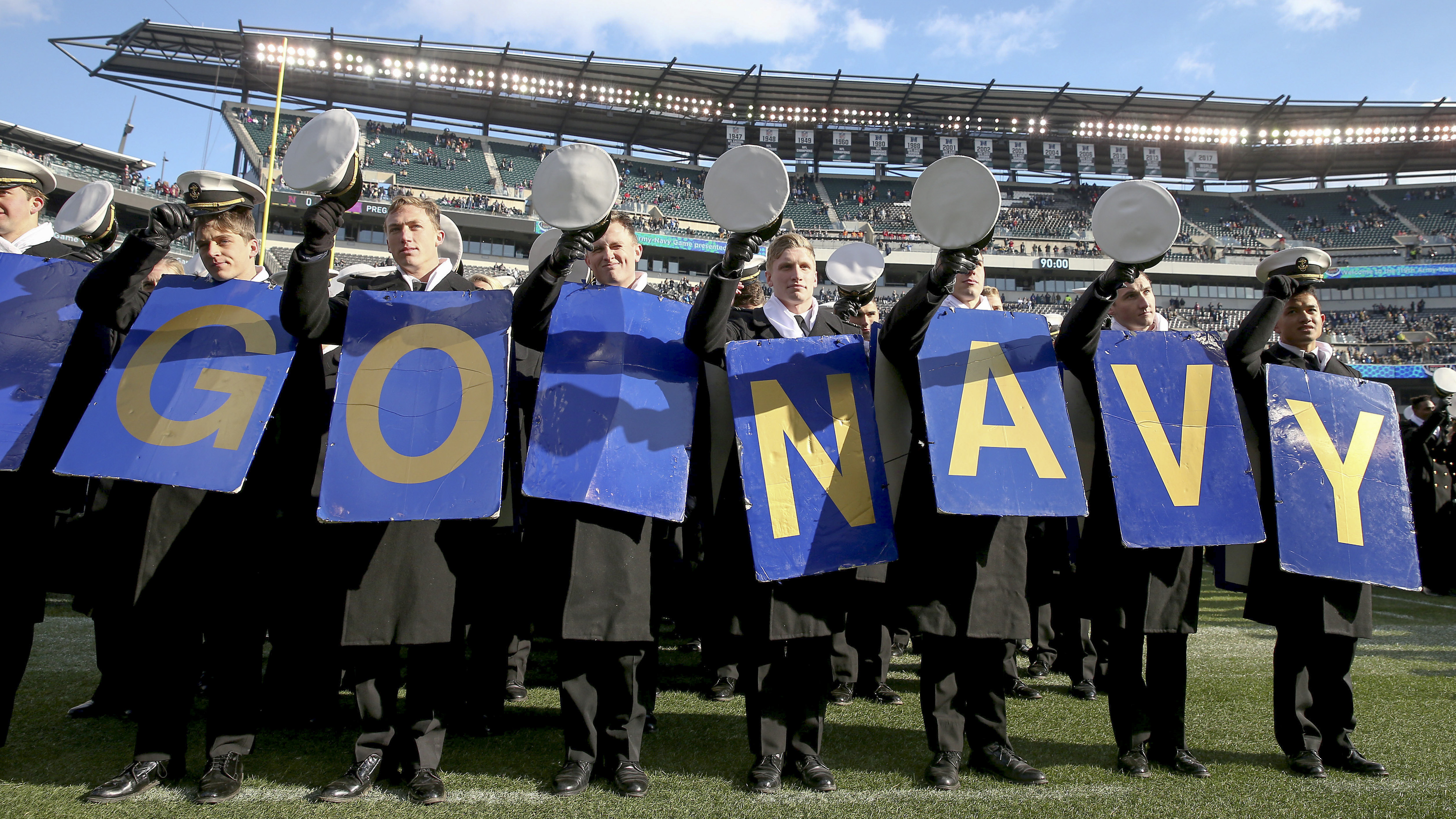 The Naval cadets celebrate after they marched on the field before the game between the Army Black Knights and the Navy Midshipmen on December 8, 2018 at Lincoln Financial Field in Philadelphia, Pennsylvania. (Photo by Elsa/Getty Images)