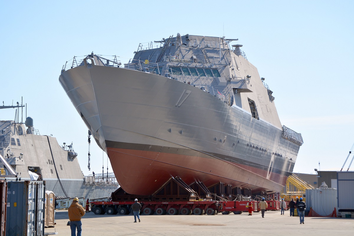 The littoral combat ship USS Indianapolis (LCS 17) is moved from an indoor production facility in Marinette, Wisc. The future LCS 25, 26 and 28 will have new shipboard terminals build by L3 Technologies. (Val Ihde/Marinette Marine)