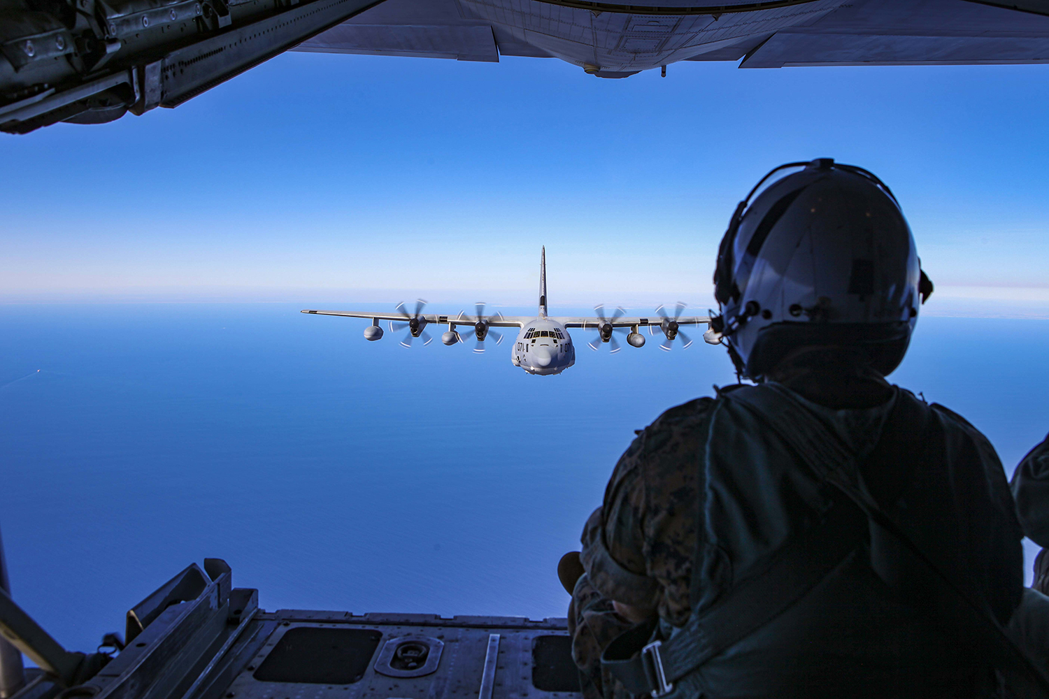 A U.S. Marine Corps KC-130J Super Hercules with Special Purpose Marine Air-Ground Task Force-Crisis Response-Africa 19.2, Marine Forces Europe and Africa, flies off the coast of Spain during an air-to-air refueling rehearsal Sept. 24, 2019. (Capt. Clay Groover/Marine Corps)