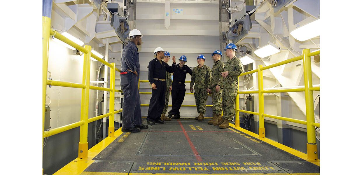 Sailors from teh aircraft carrier Gerald R. Ford's weapons department get a familiarization new advanced weapons elevator after the ship took delivery of it from the shipyard. (Mass Communication Specialist 1st Class Jeff Troutman/Navy)