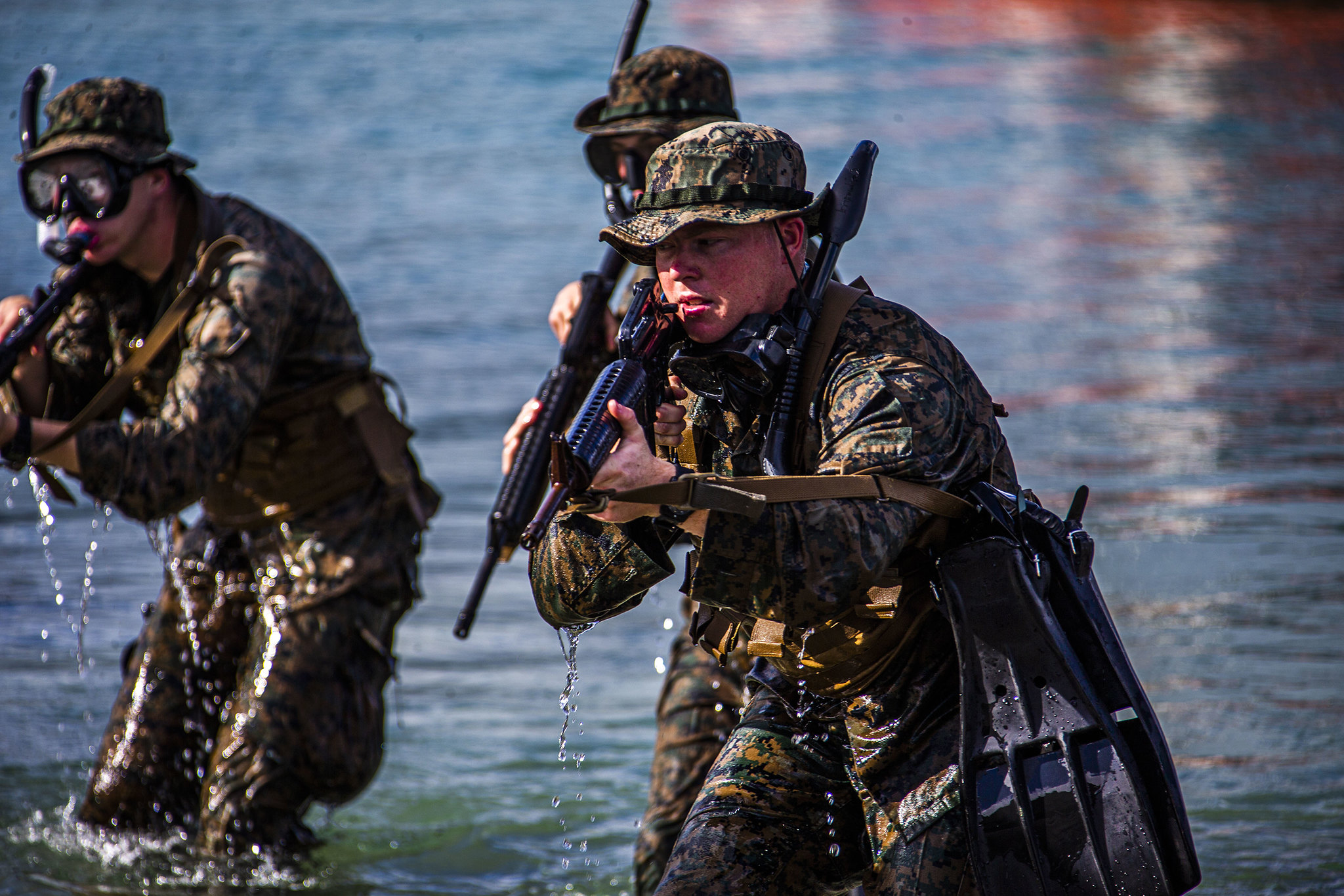 Marines hit the shore during an amphibious assault exercise on Marine Corps Base Hawaii, April 28, 2020. (Lance Cpl. Jacob Wilson/Marine Corps)