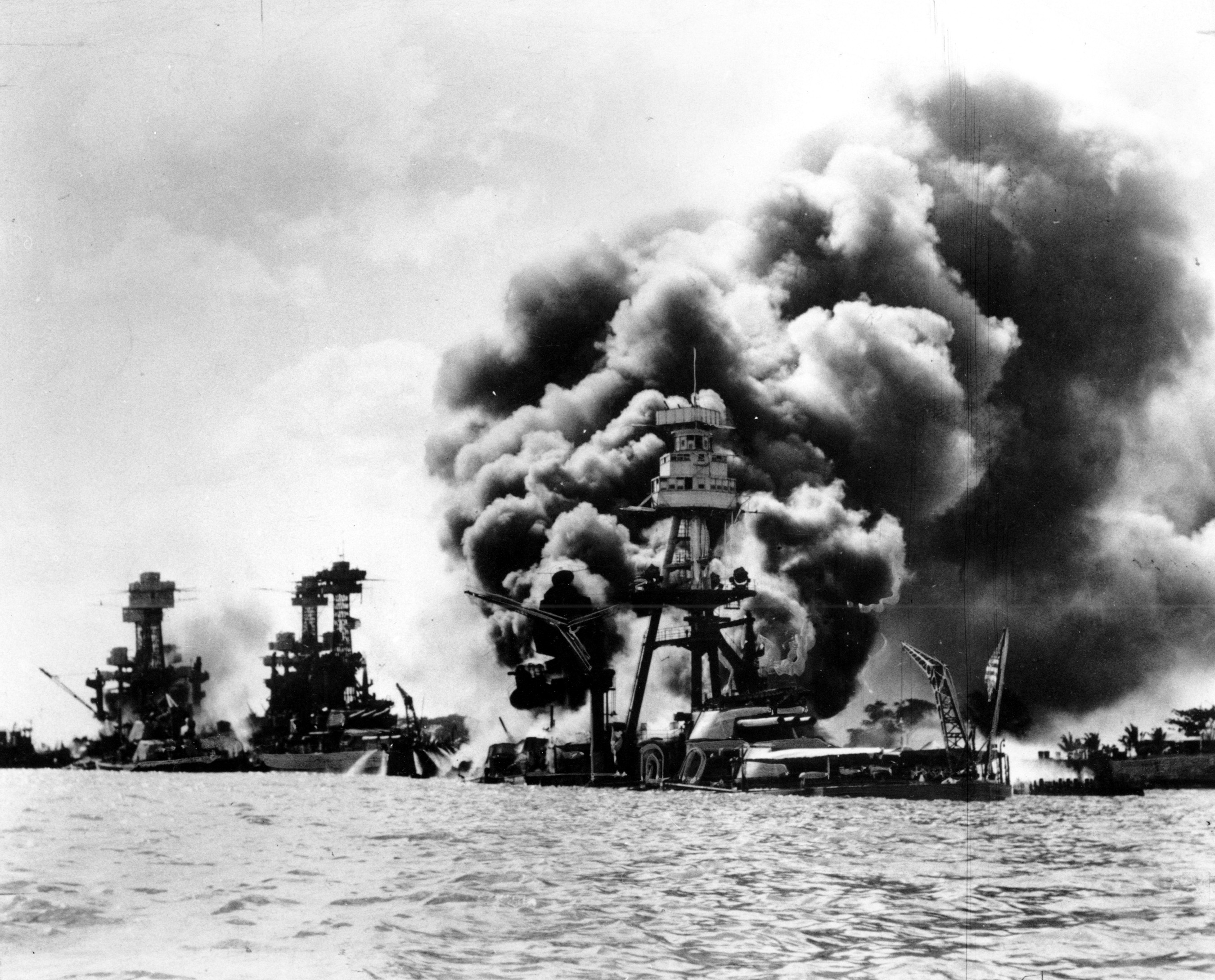 Three U.S. battleships are hit from the air during the Japanese attack on Pearl Harbor on Dec. 7, 1941. Japan's bombing of U.S. military bases at Pearl Harbor brings the U.S. into World War II. From left are: USS West Virginia, severely damaged; USS Tennessee, damaged; and USS Arizona, sunk. (AP Photo)