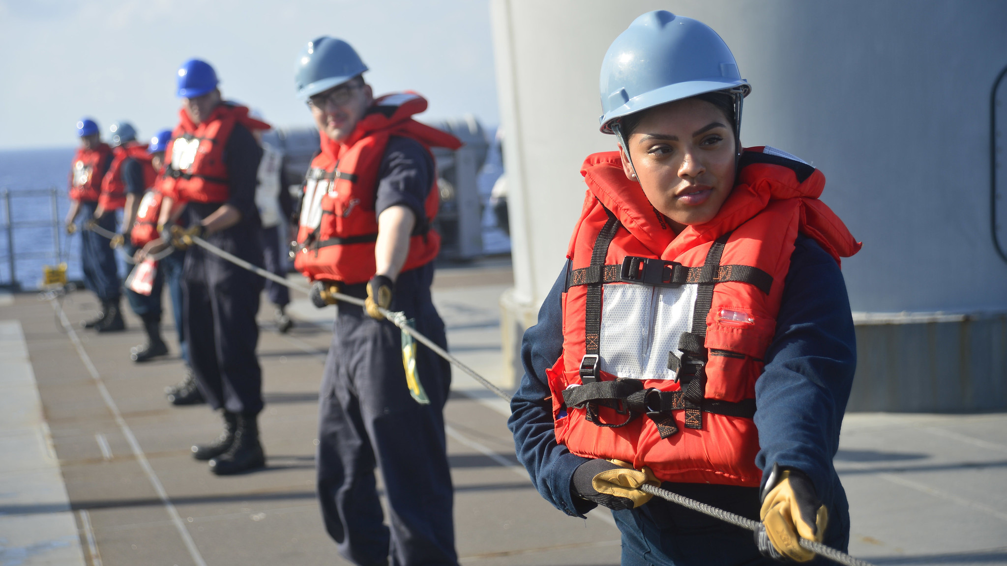 Personnel Specialist 2nd Class Elida Villalobos, from Salem, Ore., heaves around line to Fleet Replenishment Oiler USNS Guadalupe (T-AO 200) during a replenishment-at-sea with U.S. 7th Fleet Flagship USS Blue Ridge (LCC 19) in the South China Sea, March 20, 2019. (Mass Communication Specialist 3rd Class Mar'Queon A. D. Tramble/Navy)