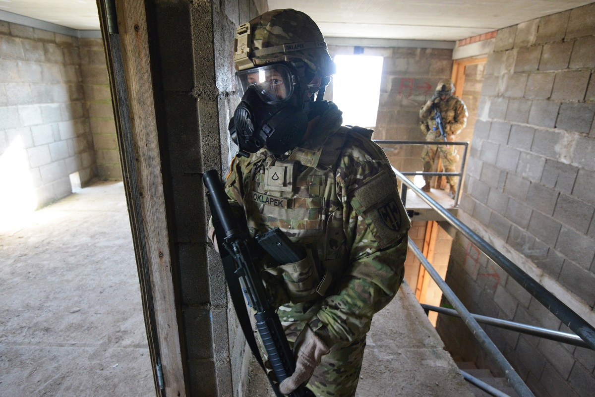A soldier with the 615th Military Police Company, 709th Military Police Battalion, 18th Military Police Brigade provides security during urban operations training at the Grafenwoehr Training Area in Germany. (Gertrud Zach/Army)