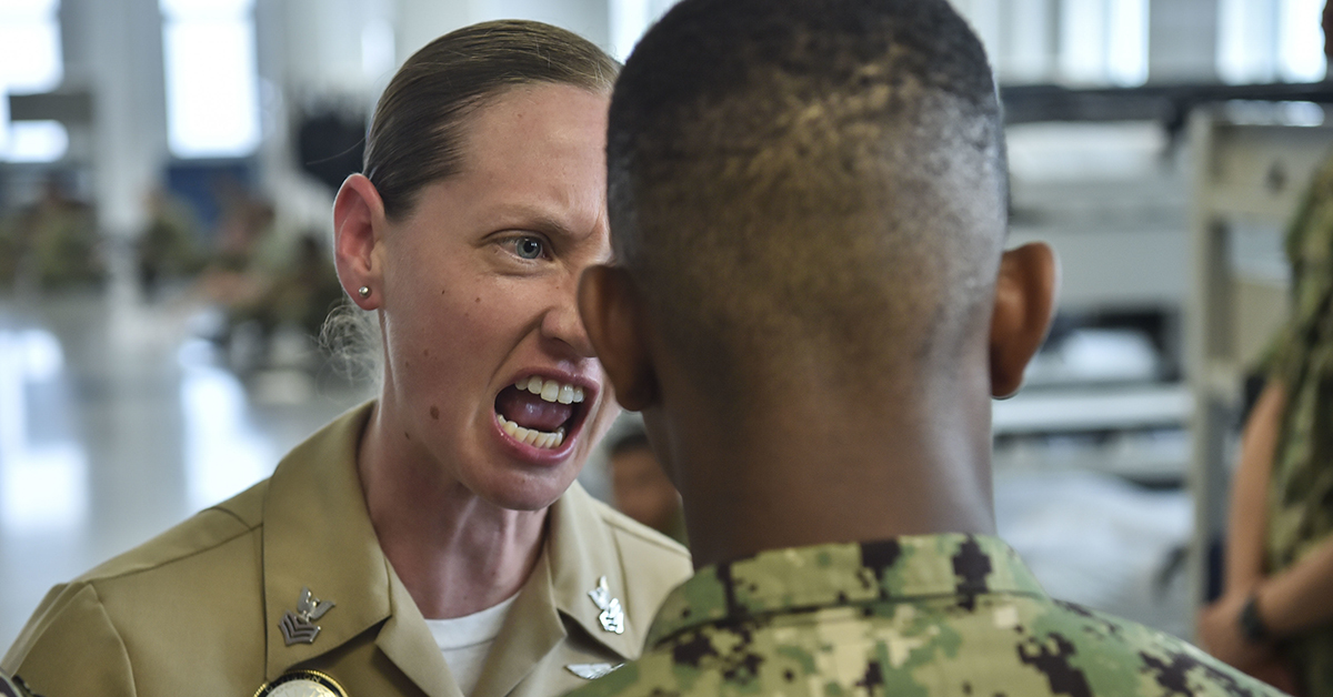 Aviation MachinistÕs Mate 1st Class Sabrina Mayo, from El Paso, Texas, provides intensive training to one of her divisionÕs recruits at Recruit Training Command (RTC). About 38,000 to 40,000 recruits graduate annually from the Navy's only boot camp. (MC2 Timothy Schumaker/Navy)