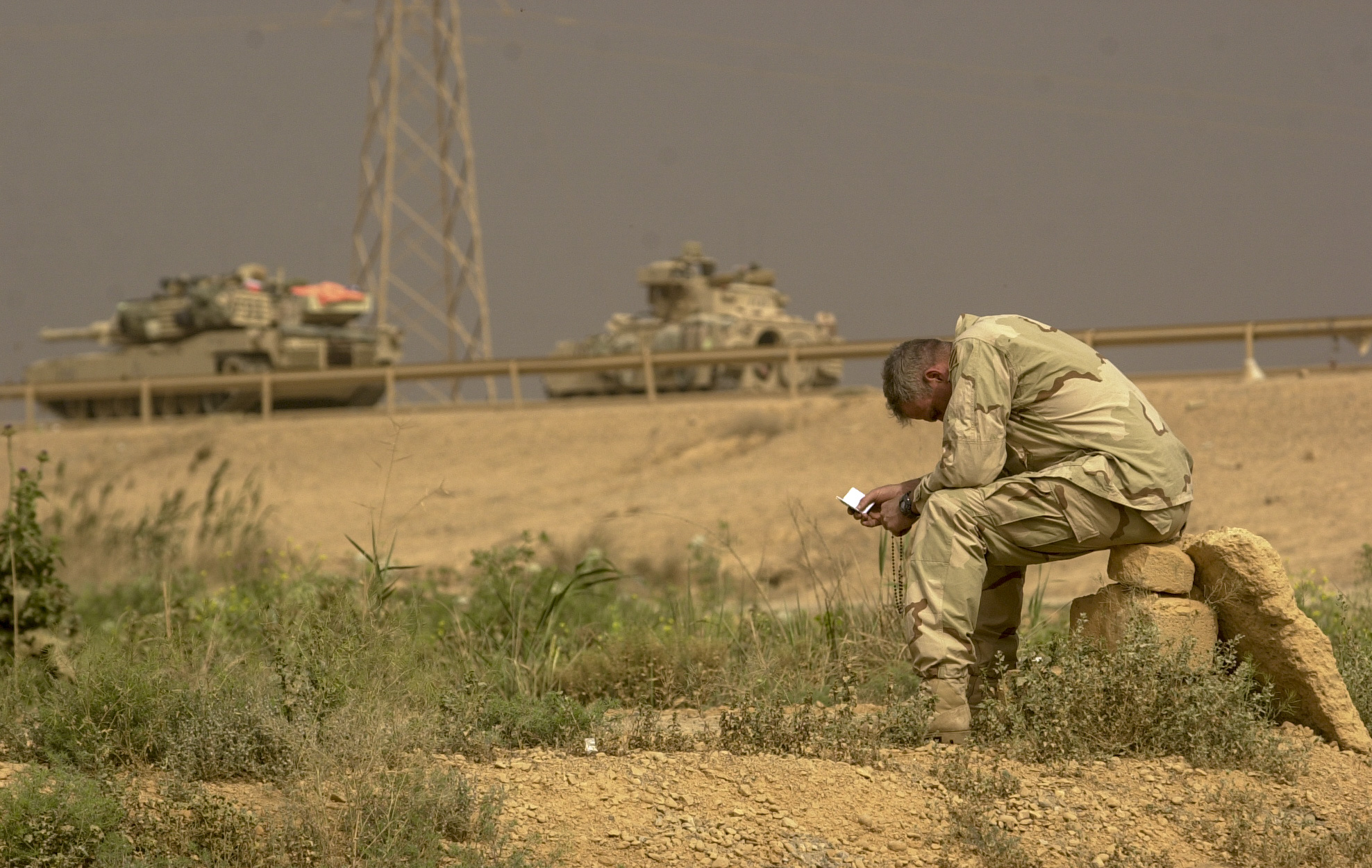 Cpt. Bill Brown, 34 of Savannah, Ga takes advantage of a pause in action to find a quiet place to pray. Brown is with the U.S. Army's 3rd Squadron, 7th Cavalry Regiment. The Cavalry is currently holding a blocking position in the south of Baghdad to control all traffic moving in and out of the city. (Warren Zinn/Army Times)