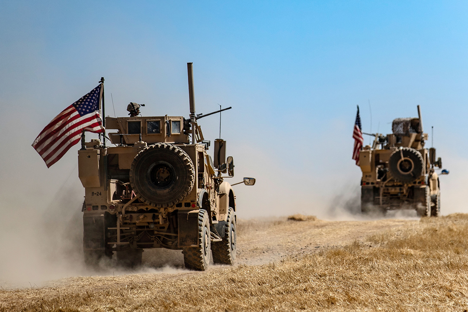 A U.S. military convoy takes part in joint patrol with Turkish troops in the Syrian village of al-Hashisha on the outskirts of Tal Abyad town along the border with Turkish troops, on Sept. 8, 2019. (Delil Souleiman/AFP via Getty Images)