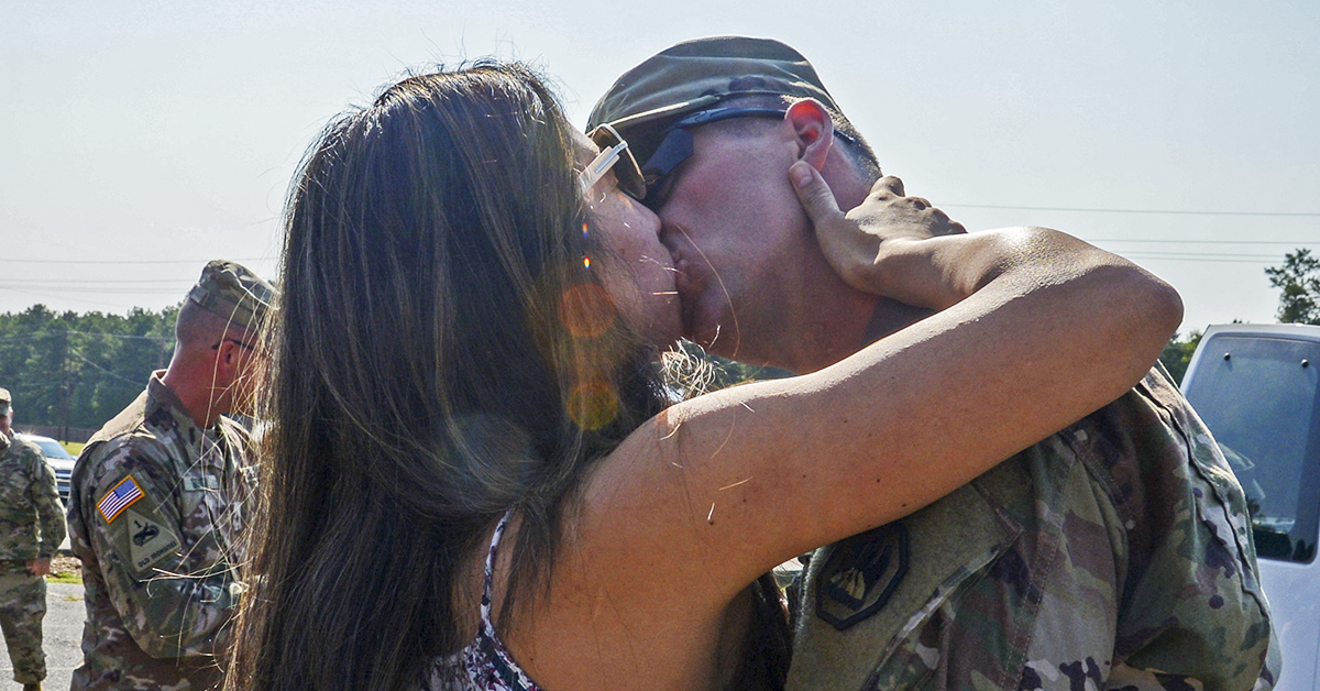 Guardsman with the Louisiana National Guard's 139th Regional Support Group receives his first kiss, at Camp Beauregard in Pineville, Louisiana, after returning from a nine-month deployment to Iraq in support of Operation Inherent Resolve, August 22, 2018. (Sgt. Noshoba Davis/Army National Guard)