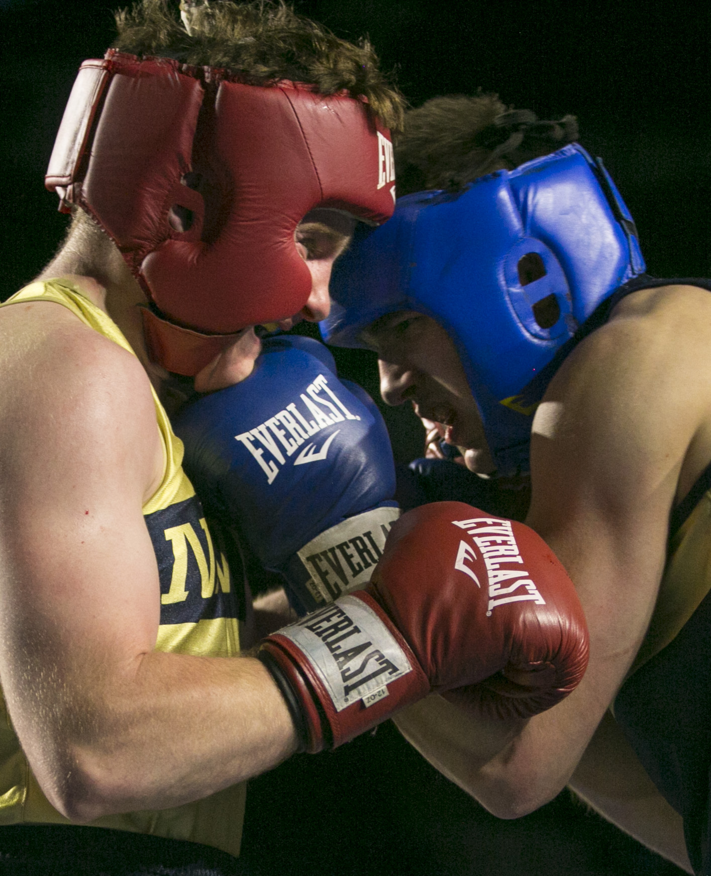 Jay Packer, (in gold) and Charlie Akerblom, (in blue), both from Philadelphia, PA, slug it out in the 185 lb weight class during the United States Naval Academy's 77th Brigade Boxing Championships held on Feb. 23, 2018. Akerblom won the fight. (Alan Lessig/Staff)