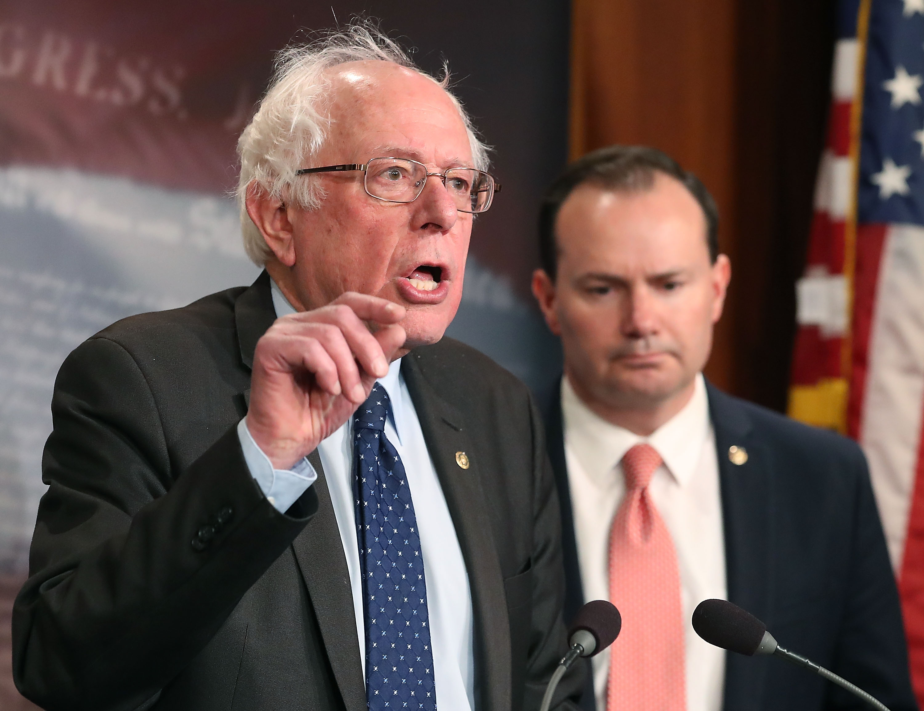 Sen. Bernie Sanders, I-Vt., left, and Sen. Mike Lee, R-Utah, introduce a joint resolution to remove U.S. armed forces from hostilities between the Saudi-led coalition and the Houthis in Yemen, on Capitol Hill Feb. 28, in Washington, D.C. They have since reintroduced the measure, which Sanders expects to see a vote before year's end. (Photo by Mark Wilson/Getty Images)
