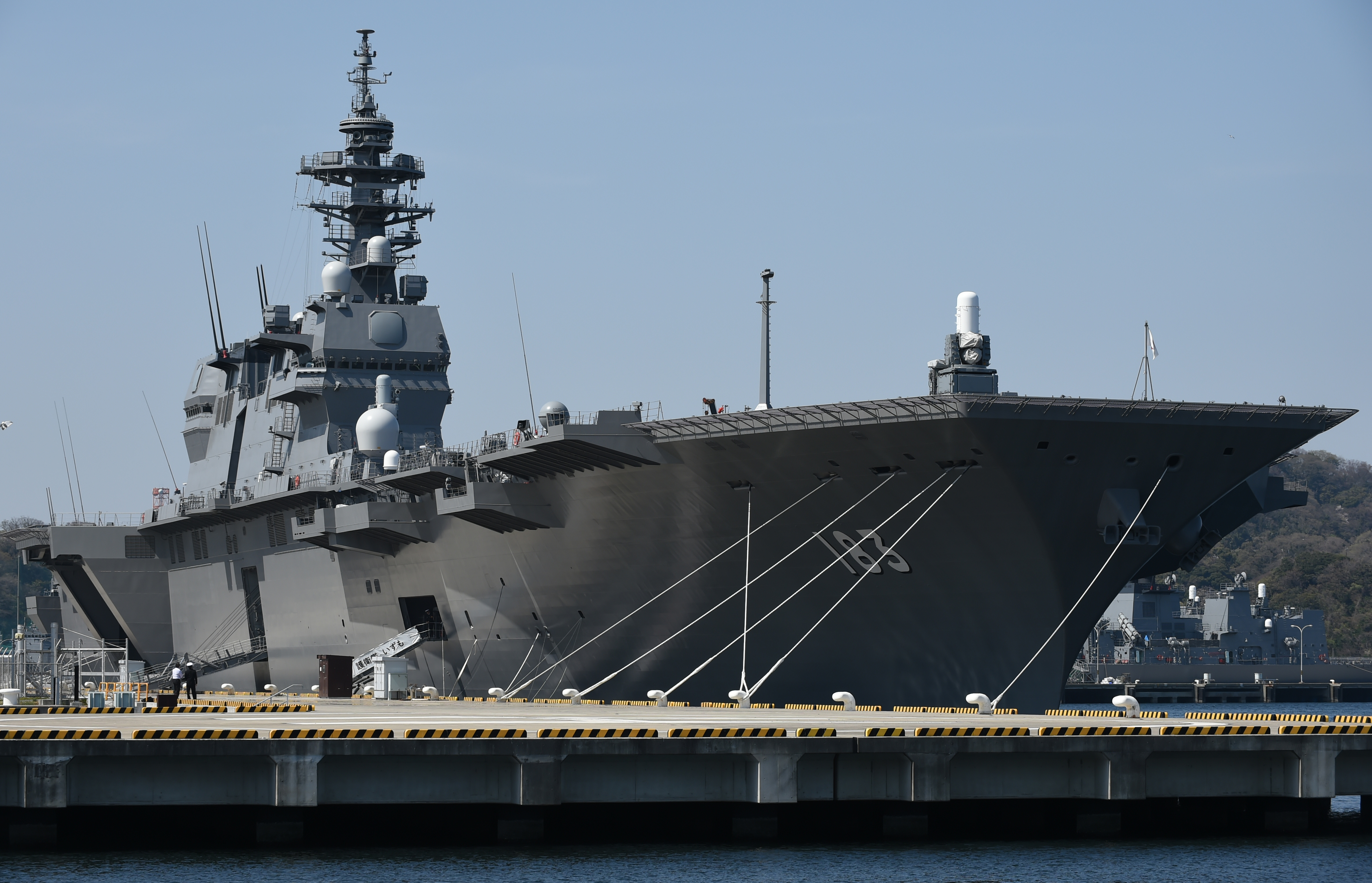 Japan Maritime Self Defense Forces' latest helicopter destroyer Izumo anchors at its Yokosuka base in Yokosuka on March 31, 2015. The JS Izumo (DDH-183), with a length of 248-meters and displacing 19,500 tons, is the largest vessel procured by the MSDF ever. (Toshifumi Kitamura/AFP)