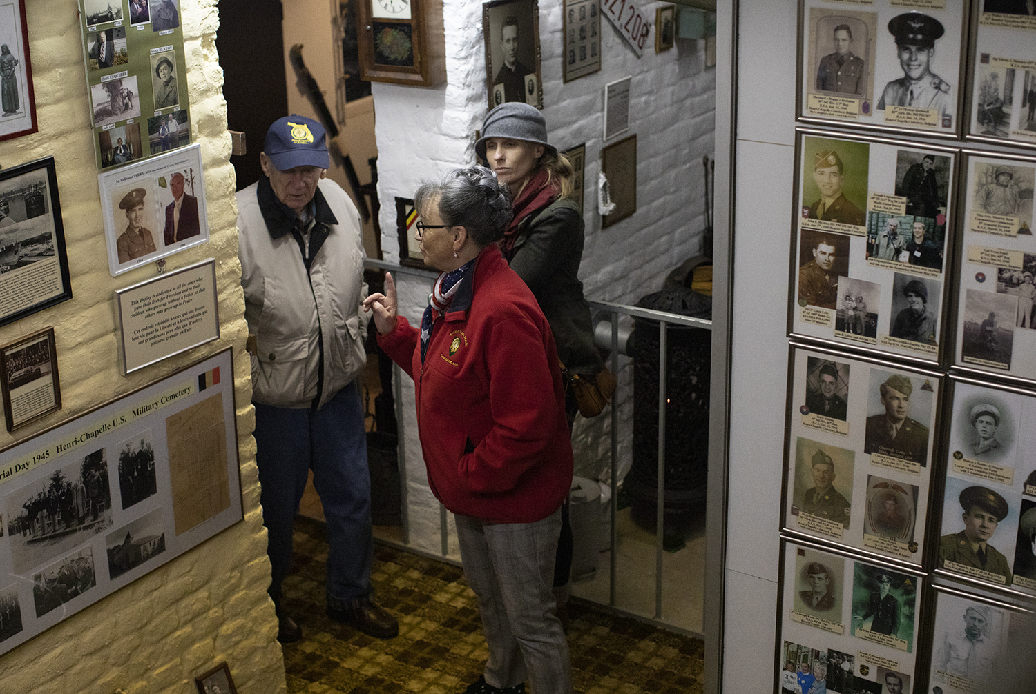 In this photo taken on Tuesday, Dec. 10, 2019, Mathilde Schmetz takes U.S. Battle of the Bulge veteran Arthur Jacobson, left, through the Remember Museum 39-45 in Thimister-Clermont, Belgium. (Virginia Mayo/AP)