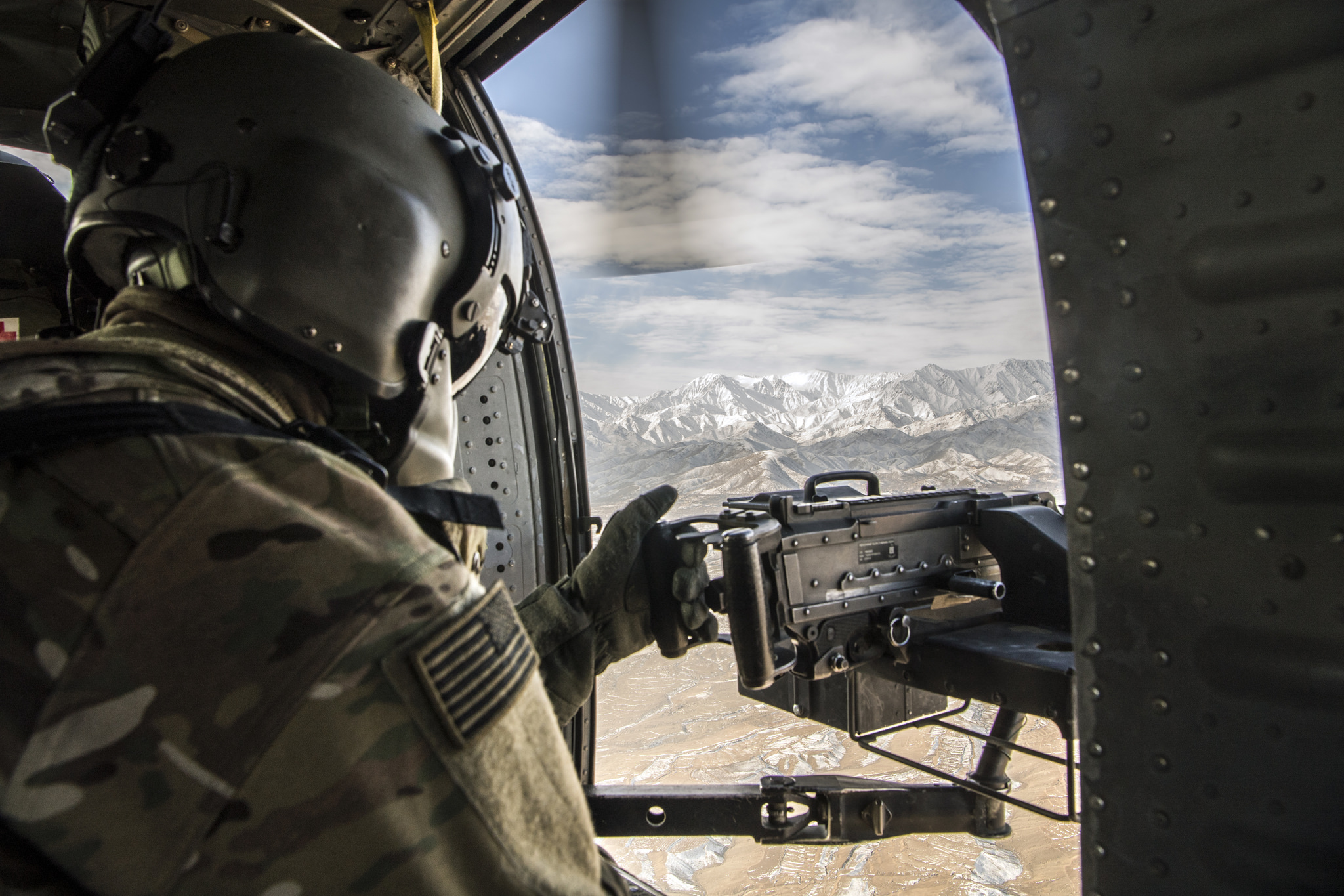 U.S. Army Soldier, assigned to 3rd Infantry Division, conducts aerial observation over Afghanistan. U.S. Army photo by John Martinez