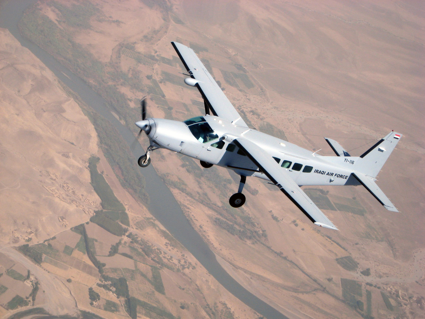 A Cessna 208 Caravan assigned to the Iraqi Air Force Flying Training Wing at Kirkuk Regional Air Base, Iraq, flies over northern Iraq during a recent training mission. (Lt. Col. Scott Voskovitch/U.S. Air Force)