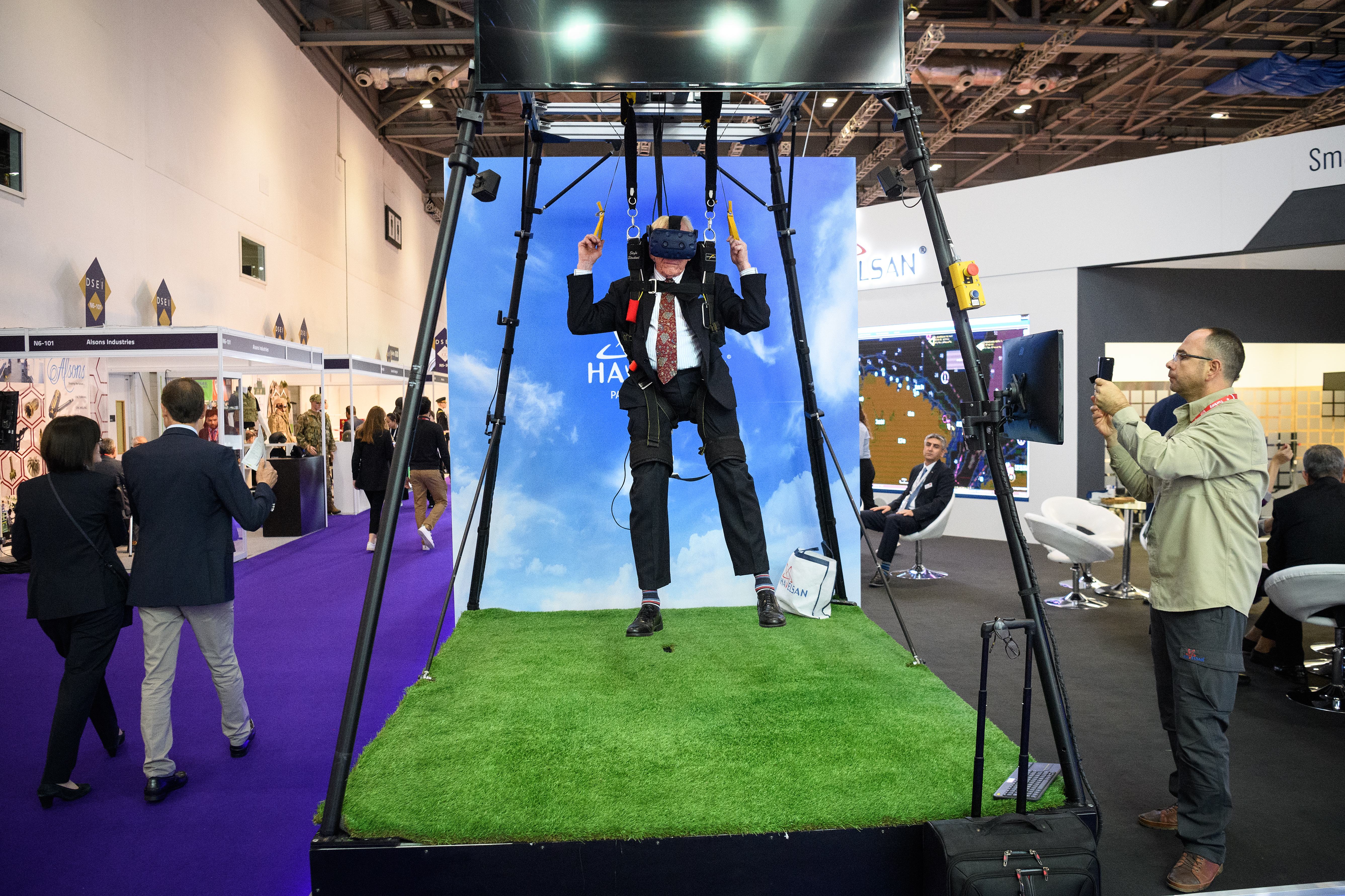 A delegate experiences a virtual parachute jump on the Havelsan display stand on the second day of the DSEI arms fair. (Leon Neal/Getty Images)