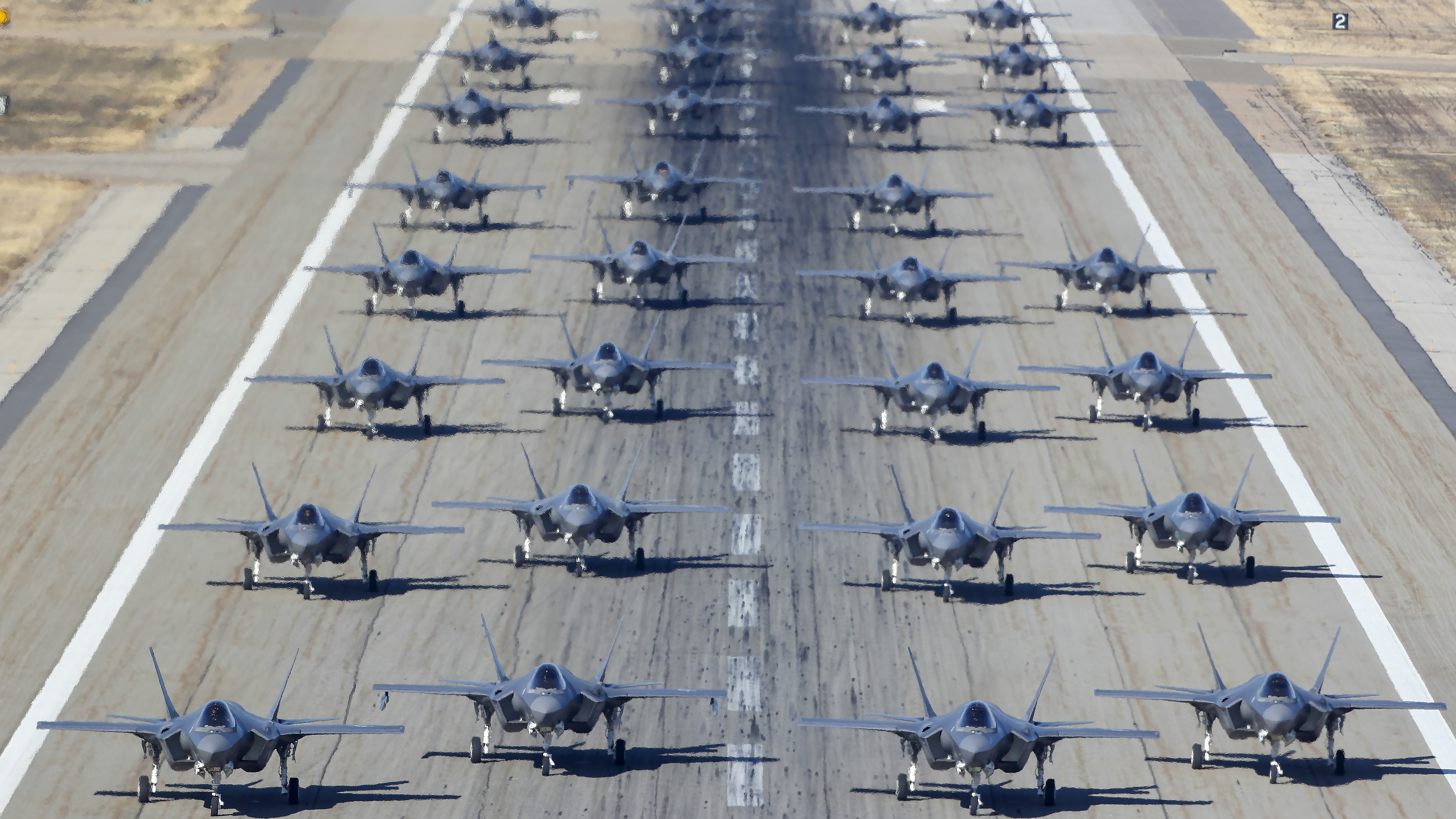 Hill Air Force Bases 388th and 419th fighter wings line up 36, F-35A's on the runway to prepare for take-off on November 19, 2018 in Hill Air Force Base, Utah. This combat training exercise is to help the 388th and 419th, the only combat ready units for the F-35A's, to be ready to launch multiple aircraft on short notice in the defense of the country. (Photo by George Frey/Getty Images)