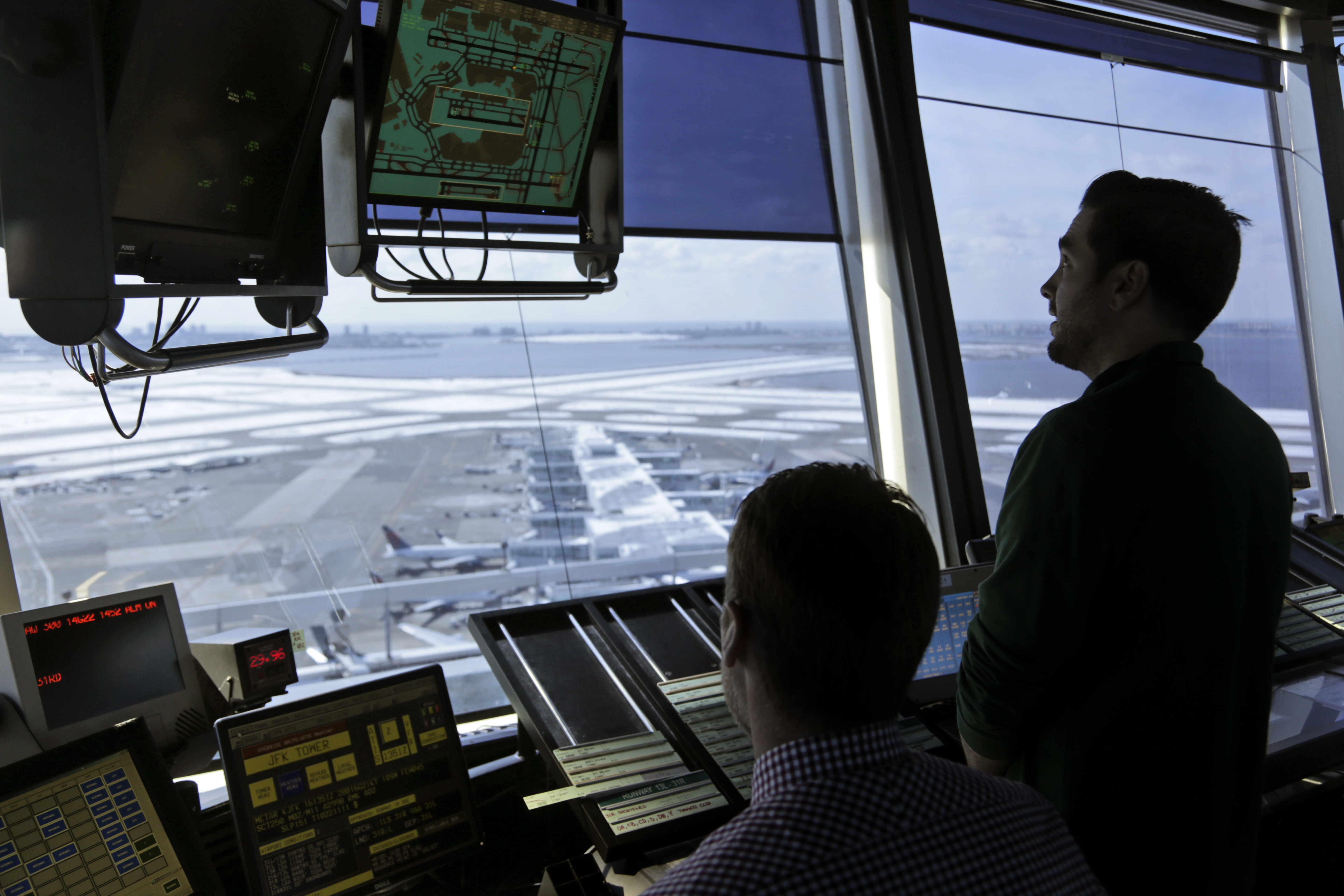 In this March 16, 2017 photo, air traffic controllers work in the tower at John F. Kennedy International Airport in New York. President Donald Trump has embraced airlines' decades-long goal of removing air traffic control operations from the government and putting industry in charge, making it a key part of his agenda to boost the nation's infrastructure through privatization. And yet, his prospects for closing the deal with Congress appear slim. (Seth Wenig/AP)