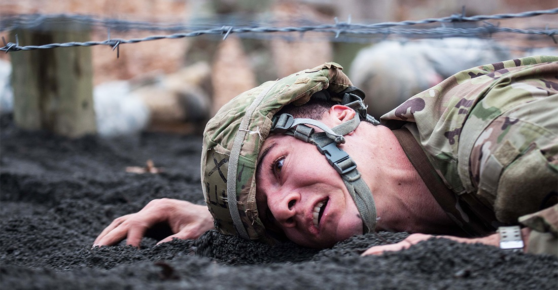 A Texas ROTC cadet makes his way under barbed wire during the 2017 Sandhurst Military Skills Competition. (Michelle Eberhart/Army)