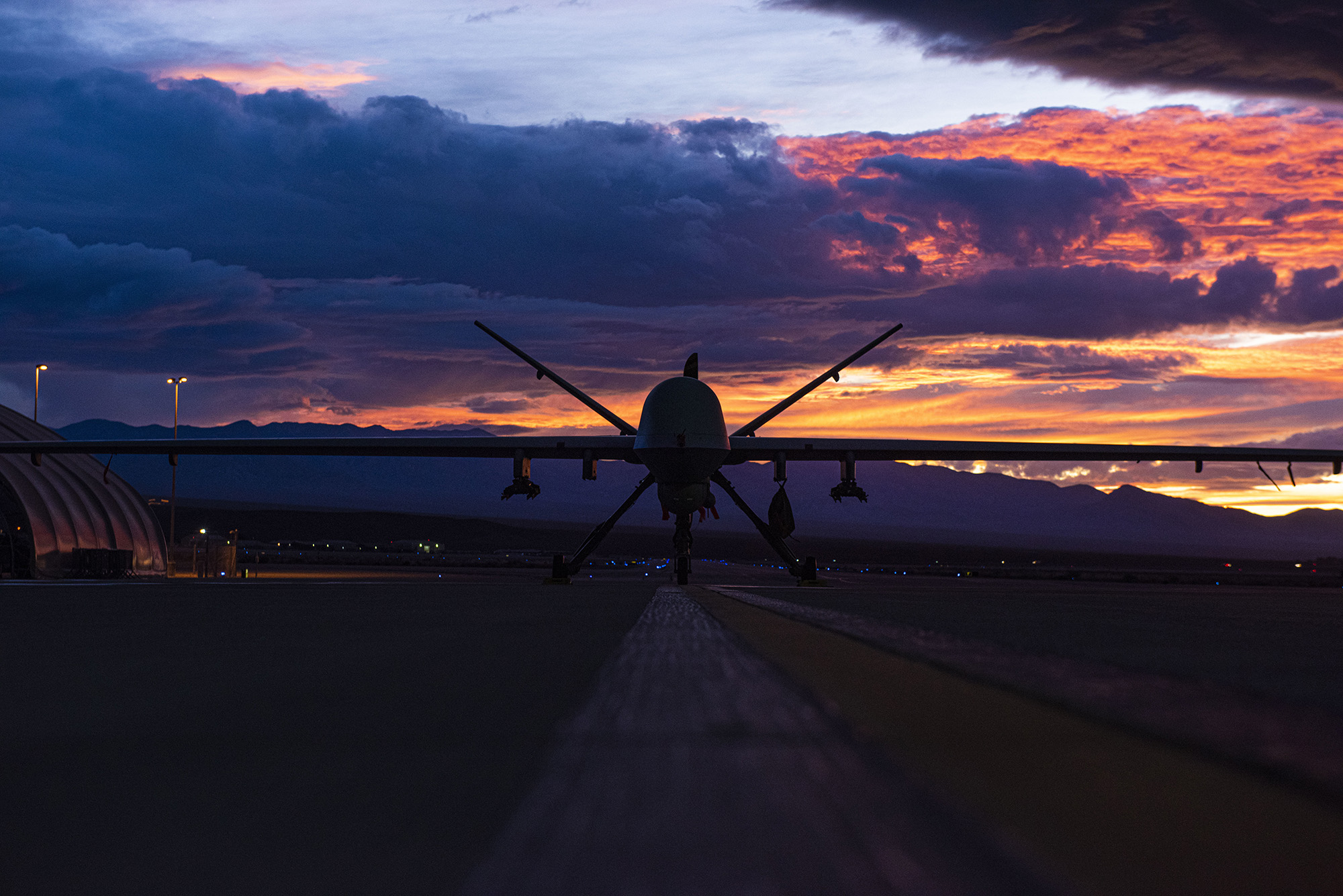 An MQ-9 Reaper sits on the flight line Nov. 20, 2019, as the sun sets at Creech Air Force Base, Nev. (Master Sgt. Dillon White/Air Force)