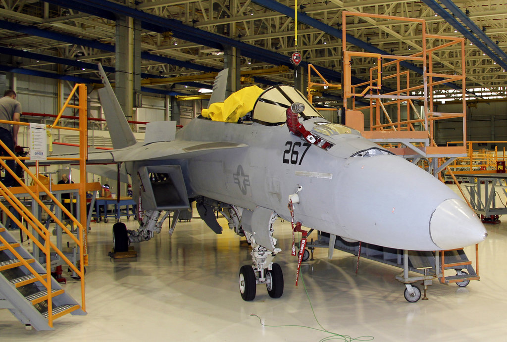 In this Wednesday, April 25, 2018, photo, the first F/A-18 Super Hornet, of many to come, undergoes updates and maintenance at Boeing's facility in St. Louis. This fighter aircraft was delivered by Boeing to the U.S. Navy in November 2004 and is at the end of its lifespan. After being refurbished, it can be piloted for an additional 3,000 flight hours, or 10-15 years. (Ted Shaffrey/AP)