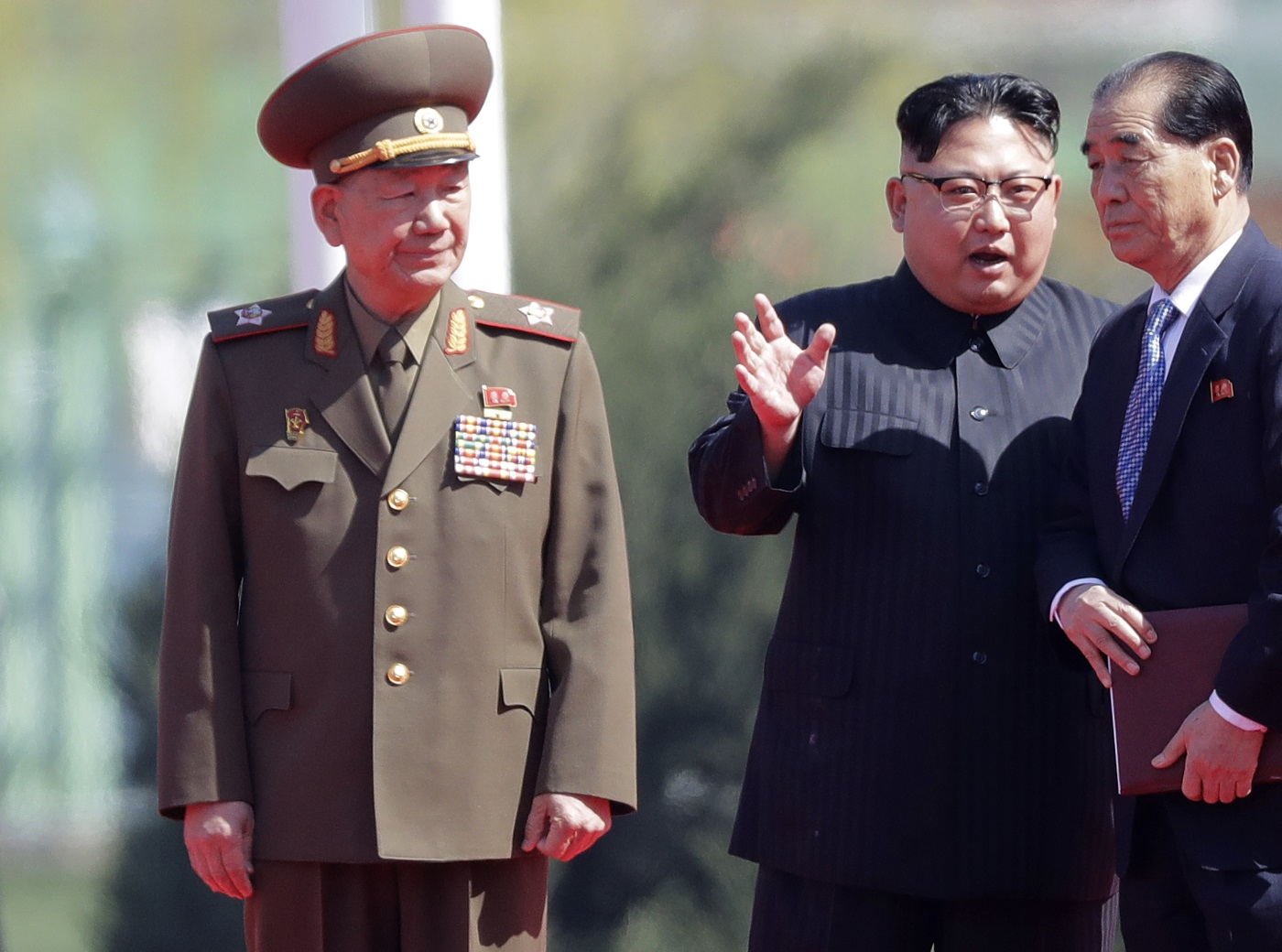 In this April 13, 2017, file photo, Hwang Pyong So, left, stands near North Korean leader Kim Jong Un, second from right, and Pak Pong Ju, right, during the opening ceremony of the Ryomyong residential area, a collection of more than a dozen apartment buildings in Pyongyang, North Korea. (Wong Maye-E/AP)