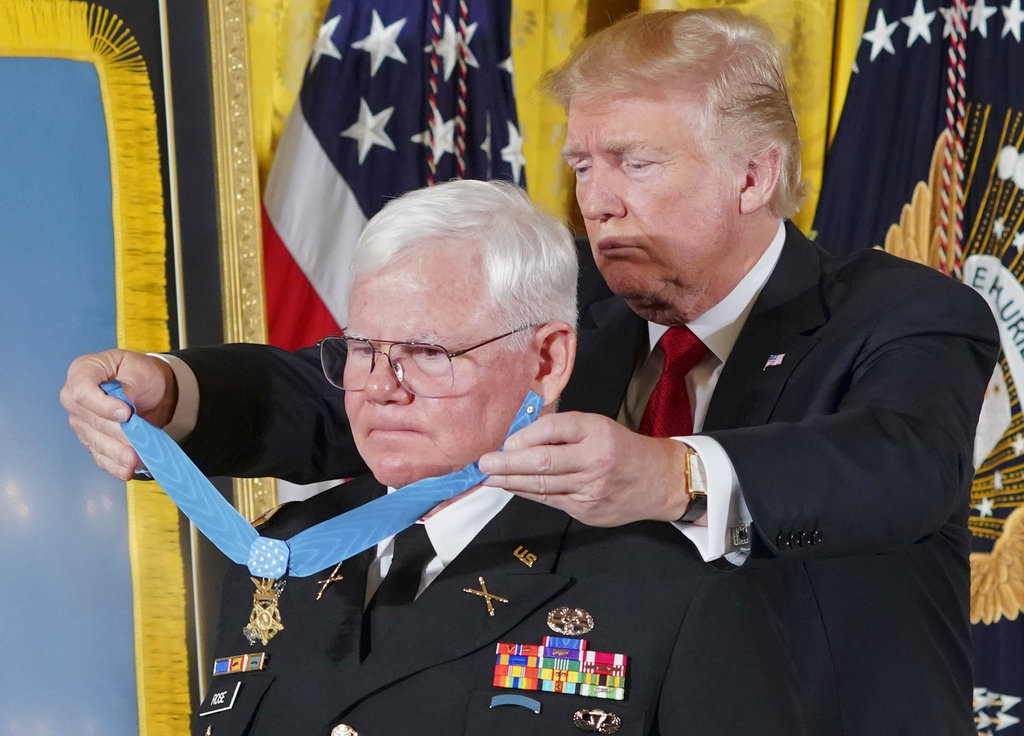 President Donald Trump bestows the nation's highest military honor, the Medal of Honor, to retired Army Capt. Gary Rose, during a ceremony in the White House Monday. (Pablo Martinez Monsivais/AP)