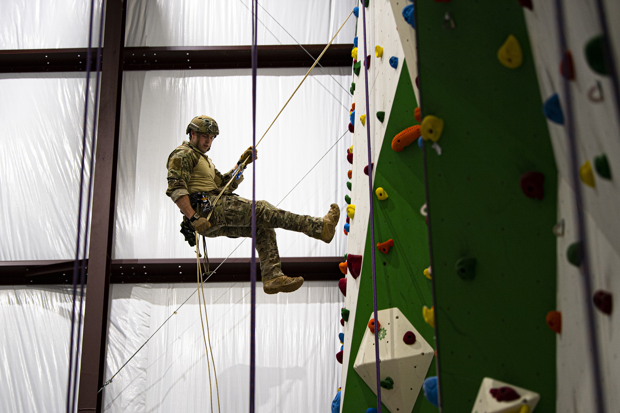 A pararescueman assigned to the 38th Rescue Squadron rappels down a climbing wall during high angle rescue training, April 28, 2020, at Moody Air Force Base, Ga. (Airman 1st Class Taryn Butler/Air Force)