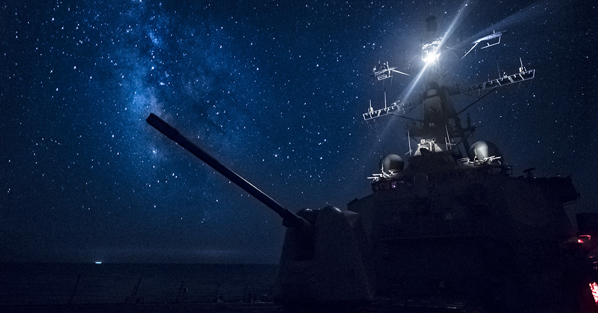 The Arleigh Burke-class guided-missile destroyer USS Carney (DDG 64) transits the Mediterranean Sea beneath a star covered sky. Carney, forward-deployed to Rota, Spain, is on its fifth patrol in the U.S. 6th Fleet area of operations in support of regional allies and partners as well as U.S. national security interests in Europe and Africa. (MC1 Ryan U. Kledzik/Navy)