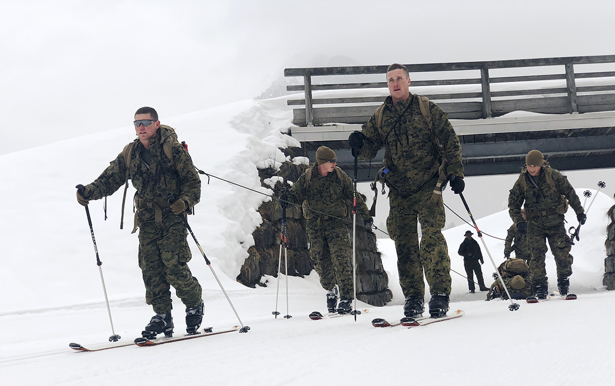 Marines from Mountain Warfare Training Center, Bridgeport, Calif., prepare to compete in the First Annual International Mountain Warfare Training Patrol Competition at the Chiemgau Arena in Ruhpolding, Germany. The competition is a challenging international competition that focuses on the mountain infantry's capabilities. (Capt. Karen Anne Holliday/Marines)