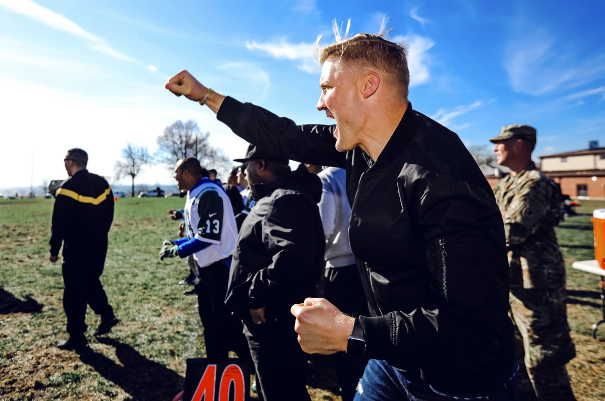 New York Jets quarterback Josh McCown cheers on his squad of military members during a flag football game at Fort Hamilton Army Base in the Brooklyn borough of New York, Tuesday, Nov. 21, 2017. (New York Jets.com/New York Jets via AP)