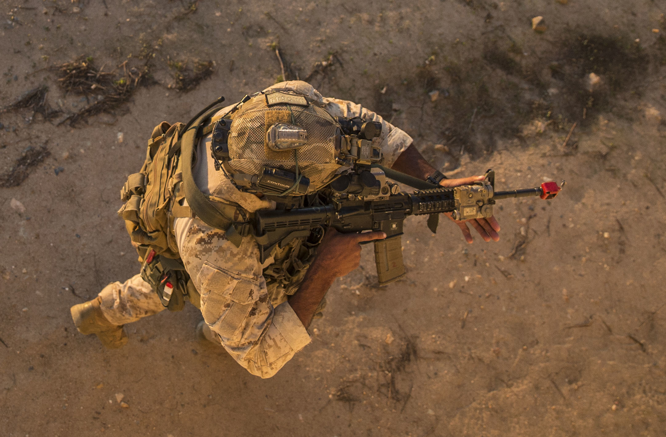 A Marine Raider conducts high-value target detainment and evacuation operations during a multipurpose canine handler training course hosted by 1st Marine Raider Battalion on Marine Corps Base Camp Pendleton, Calif,, Dec. 19, 2019. (Lance Cpl. Angela Wilcox/Marine Corps)