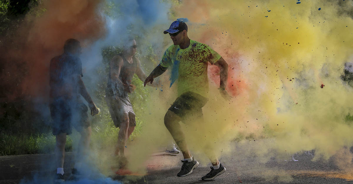 Soldiers and airmen participate in the 2018 New Jersey National Guard LGBT 5K Color Run on Joint Base McGuire-Dix-Lakehurst, New Jersey. (Master Sgt. Matt Hecht/Air National Guard)
