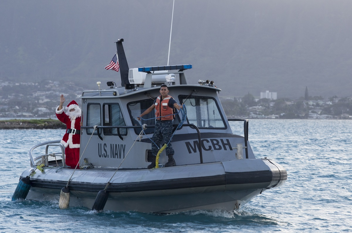 U.S. sailors with Waterfront Operations, Headquarters Battalion, rescue Santa Claus from Kaneohe Bay and bring him to the battalion's holiday party on Dec. 15, 2017, at Marine Corps Base Hawaii. (Lance Cpl. Luke Kuennen/Marine Corps)