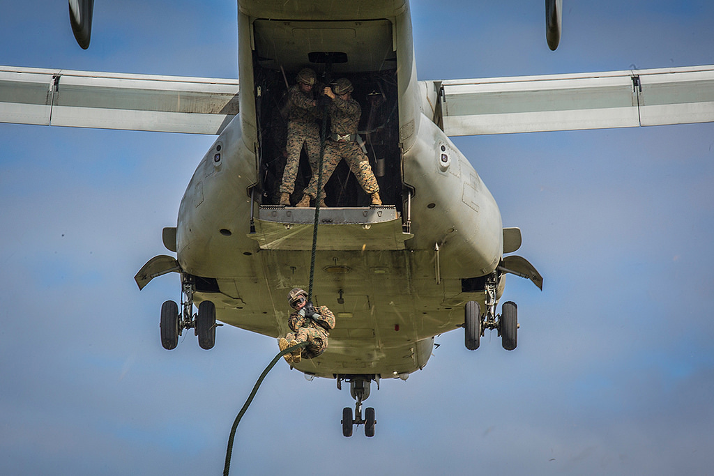 A Marine with 1st Battalion, 3rd Marine Regiment, attached to 3rd Marine Division, descends from an MV-22B Osprey on Nov. 28, 2017, at Camp Hansen, Okinawa. (Lance Cpl. Andy Martinez/Marine Corps)