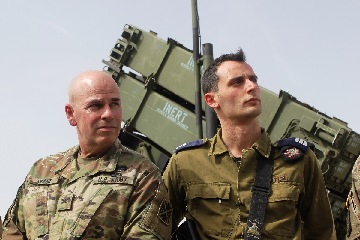 Commander of 10th Army Air and Missile Defense Command, Col. David E. Shank, left, and IDF Capt. Ron Shavit, a Patriot battery commander, wait to speak to reporters during the press briefing March 8, 2018. (Ben Hartman/Contributor)