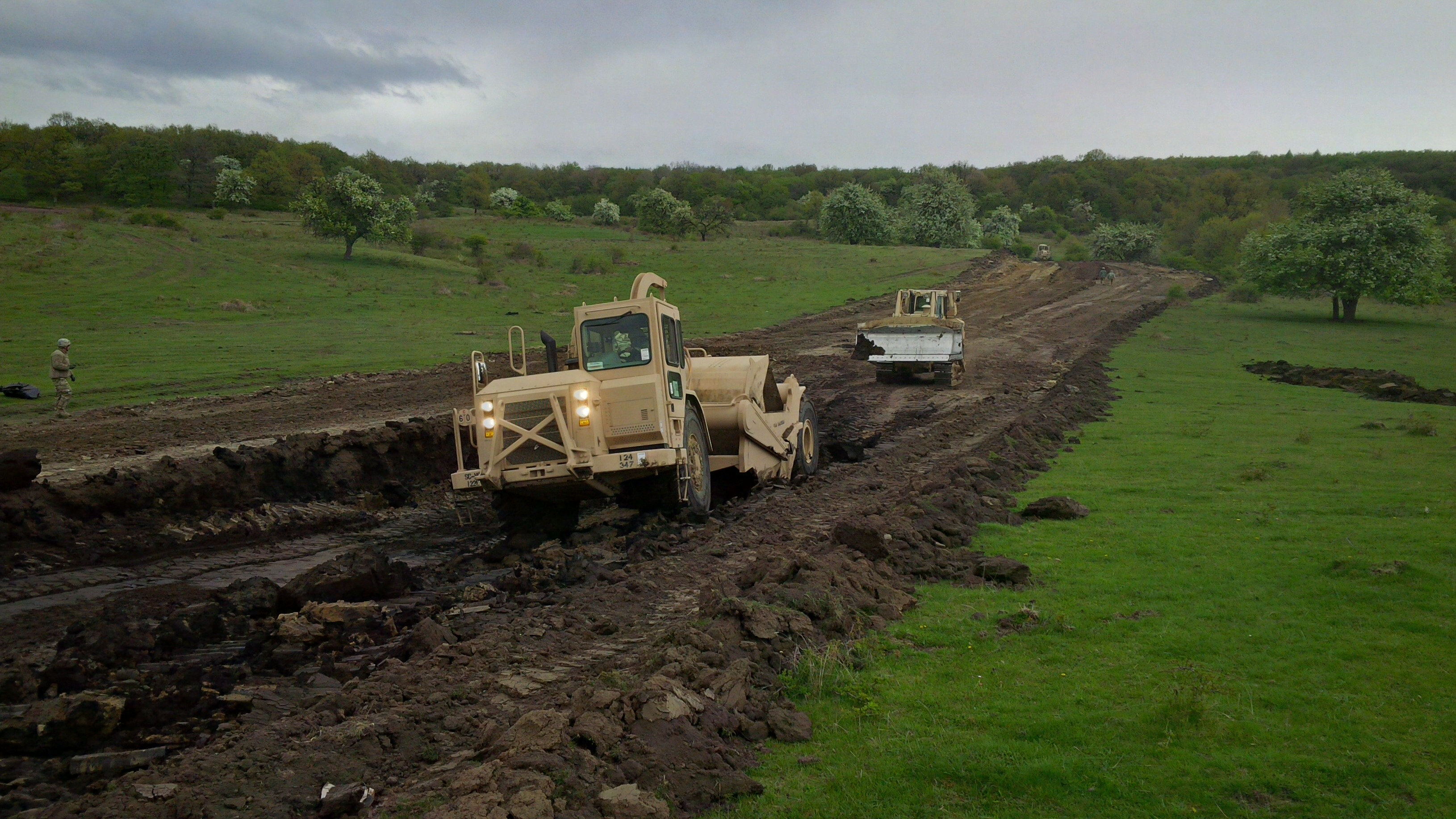 A scraper removes dirt from lane two near battle position two of the nonstandard live fire range. The area needed to be firmed up, so the soft material was excavated and backfilled with better material to solidify the surface. (Jen Judson/Staff)