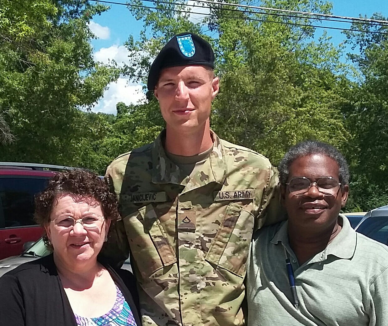 Kathleen Jacob, left, and Joseph Jacob, right, served as legal guardians for Spc. Nemanja Janicijevic when he first came to the U.S. to play basketball in Maryland as a high school freshman. Janicijevic was stuck at Fort Lee for 11 months after AIT, until his death last week. (Courtesy photo)