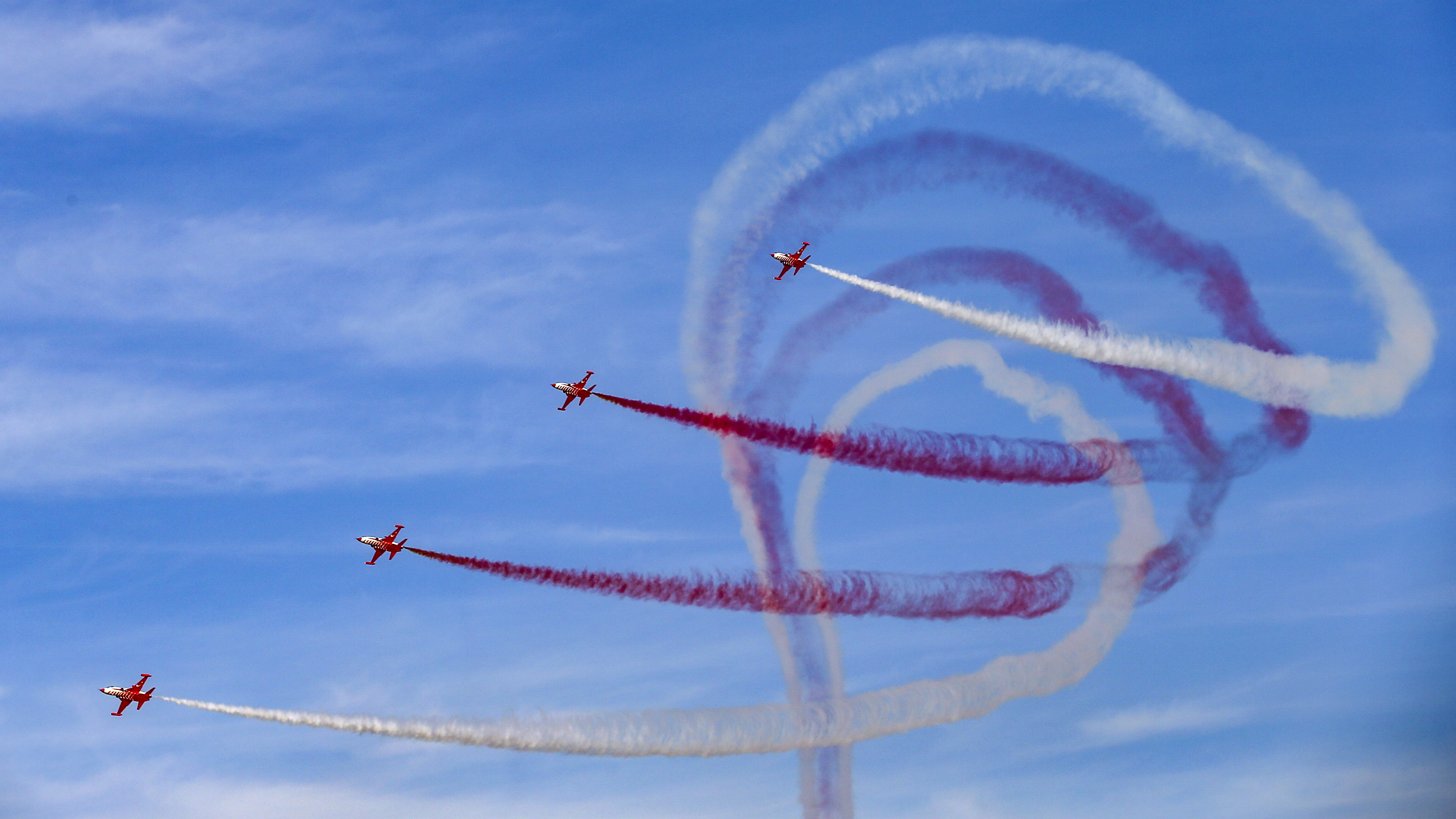 'Turkish Stars', F-5 fighter airplanes, the aerobatic team of the Turkish Air Force, fly in formation over Istanbul's new airport, during the Teknofest aviation, space and technology fair, Sunday, Sept. 23, 2018. (AP Photo/Emrah Gurel)
