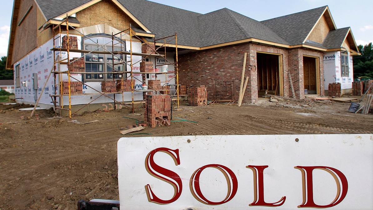 A VA-backed loan can be used to buy the land and fund the construction of your new home, but there are several hurdles to clear. (Seth Perlman/AP)