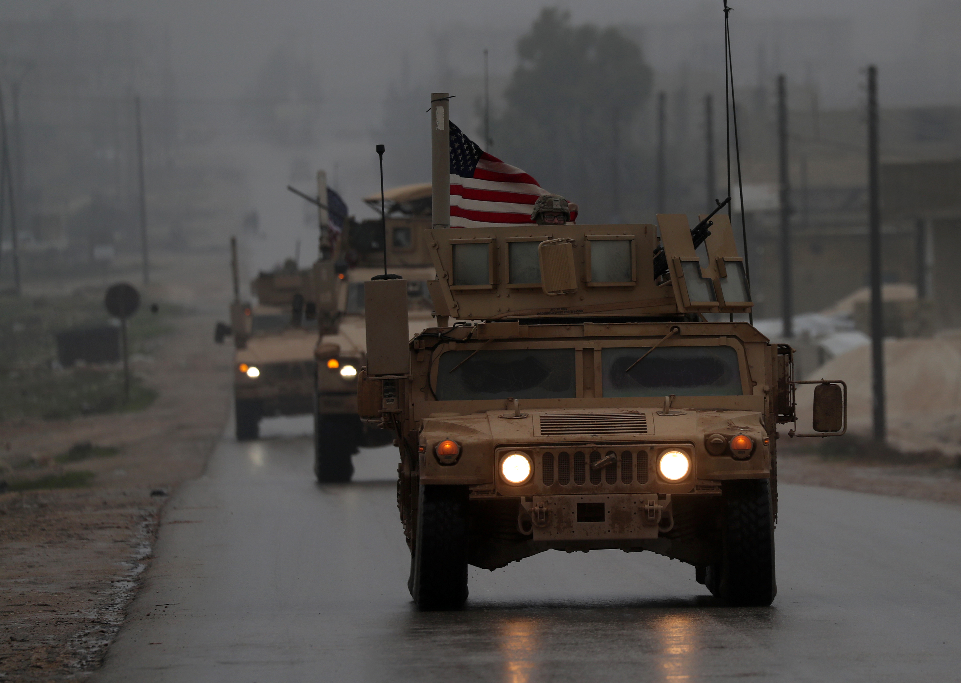 A line of US military vehicles is seen Dec. 30, 2018, in Syria's northern city of Manbij. (Delil Souleiman/AFP via Getty Images)