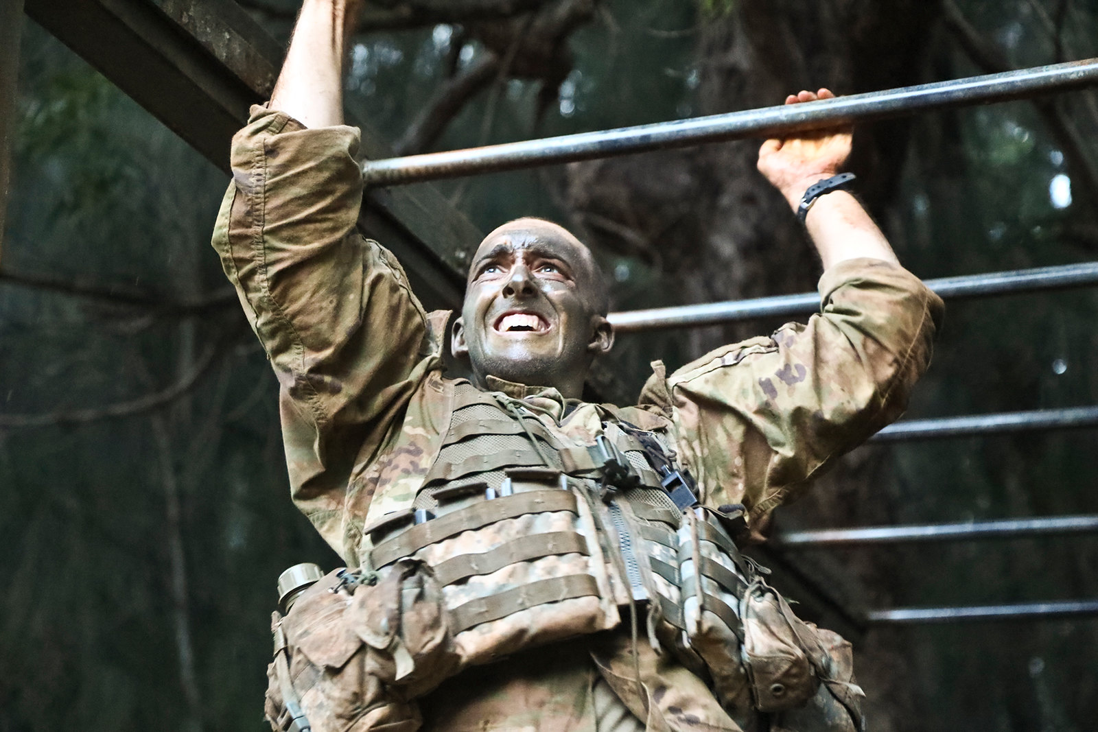 A soldier scales the monkey bars as part of the Green Mile physical endurance course during jungle training at Lightning Academy in Wahiawa, Hawaii, April 18, 2019. (Spc. Valencia McNeal/Army)