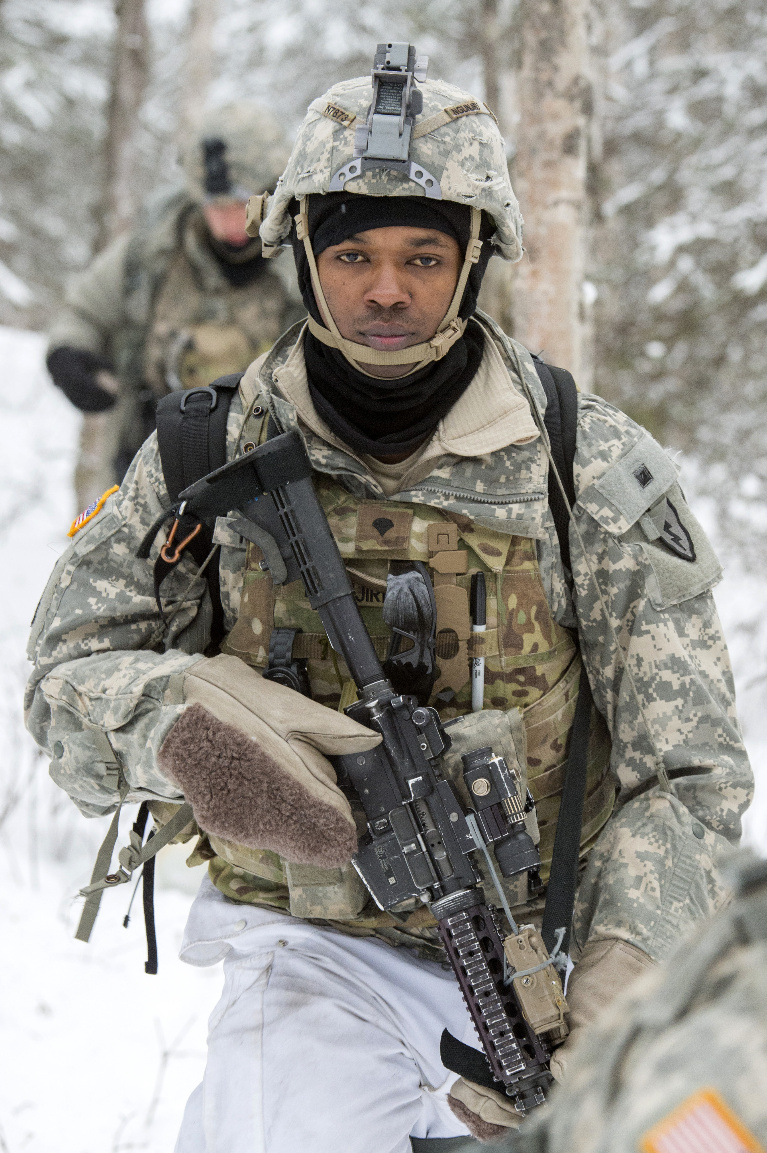 Spc. Moses Ngunjiri marches to the next objective during Operation Punchbowl at Joint Base Elmendorf-Richardson, Alaska, Feb. 10, 2018. (Alejandro Peña/Air Force)