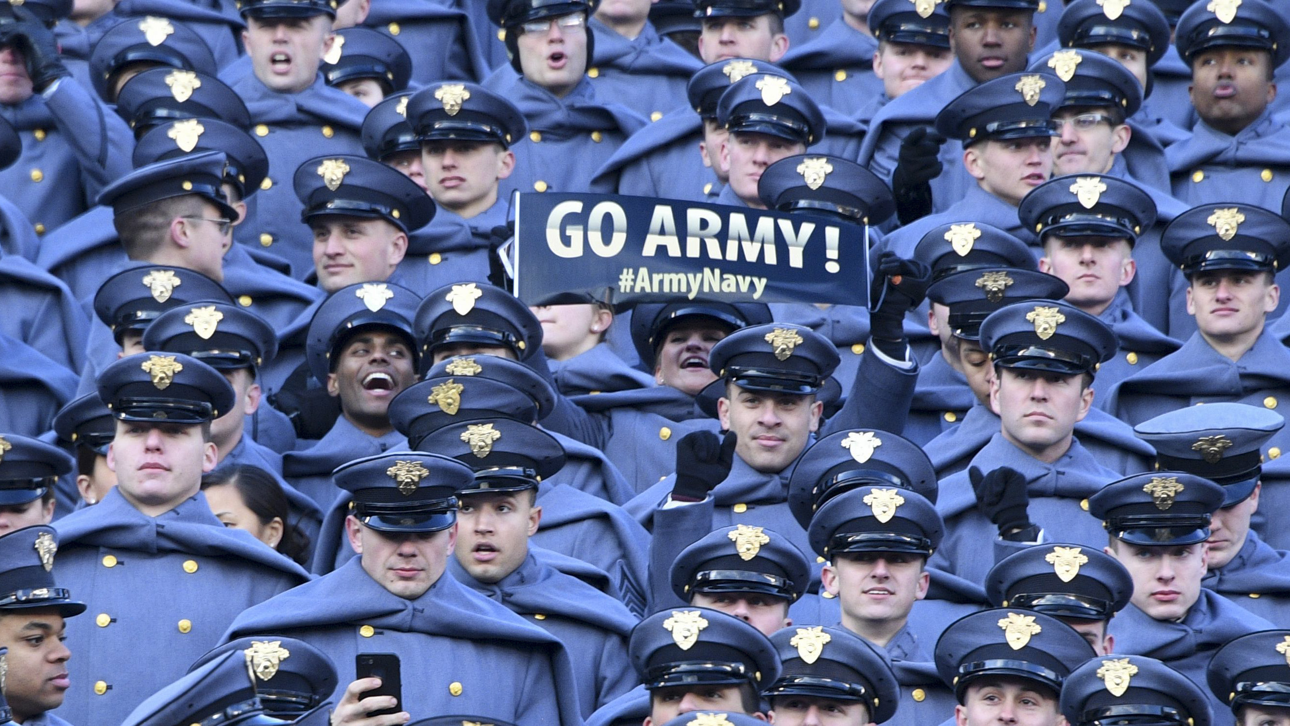US Military Academy (USMA) show their support prior to the annual Army-Navy football game at Lincoln Financial Field in Philadelphia, Pennsylvania, December 8, 2018. - Trump will officiate the coin toss at Lincoln Financial Field in Philadelphia between the Army Black Knights of the US Military Academy (USMA) and the Navy Midshipmen of the US Naval Academy (USNA). (Photo by Jim WATSON / AFP) (Photo credit should read JIM WATSON/AFP/Getty Images)