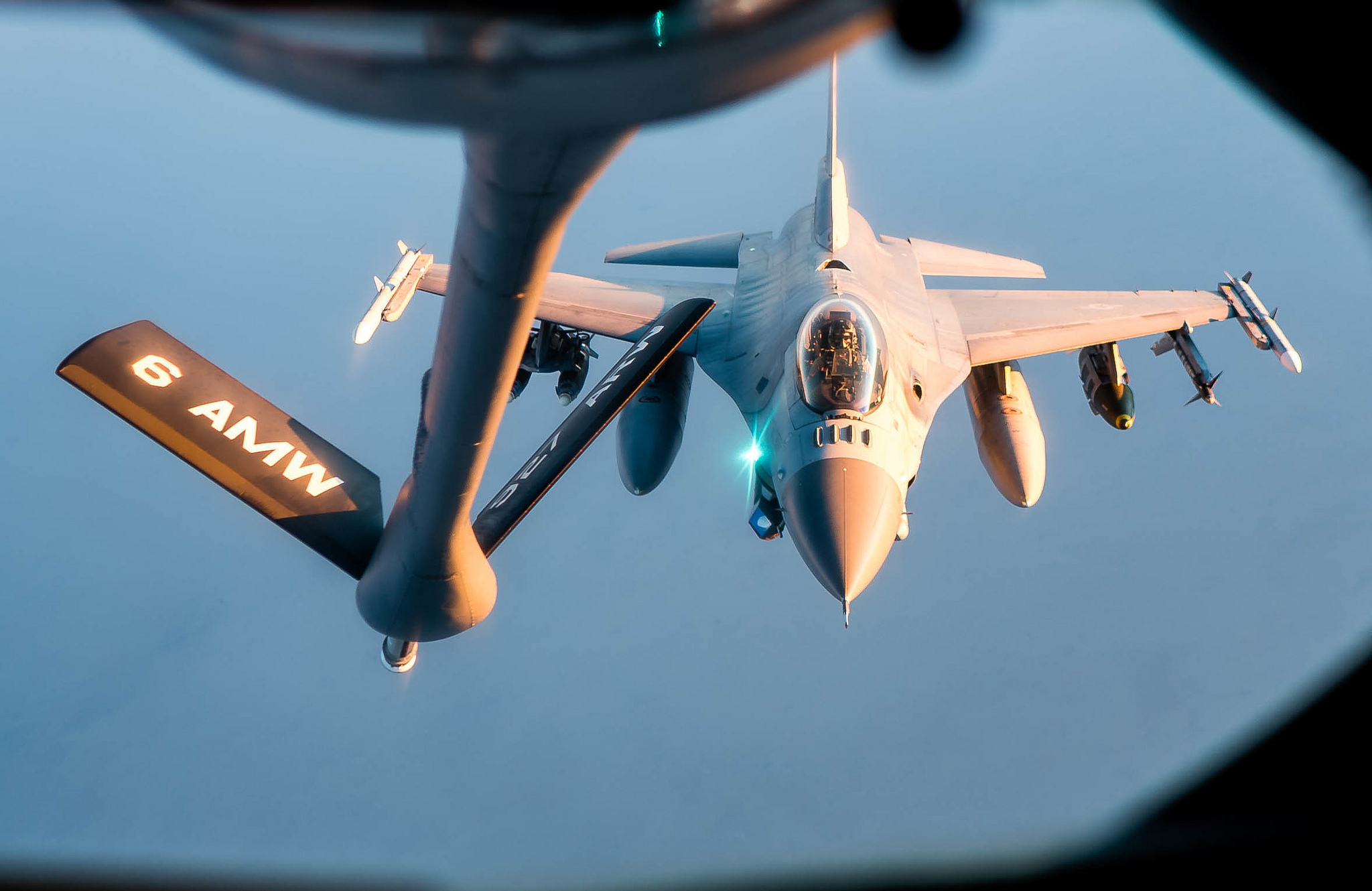 A 28th Expeditionary Aerial Refueling Squadron KC-135 Stratotanker refuels an Air Force F-16 Fighting Falcon in support of Operation Inherent Resolve, Nov. 29, 2018. (Staff Sgt. James Cason/Air Force)
