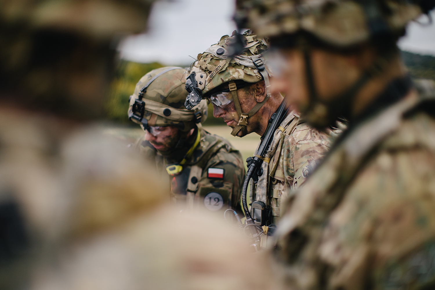 Lt. Col. Joshua Brown, the commander of 1st Squadron, 91st Cavalry Regiment, 173rd Airborne Brigade, discusses and plans upcoming operations alongside his company commanders and officers of the 2nd Battalion, 12th Brigade Polish Army in Hohenfels Training Area, Germany during Saber Junction 19 on Sept. 27, 2019. (Spc. Ryan Lucas/Army)