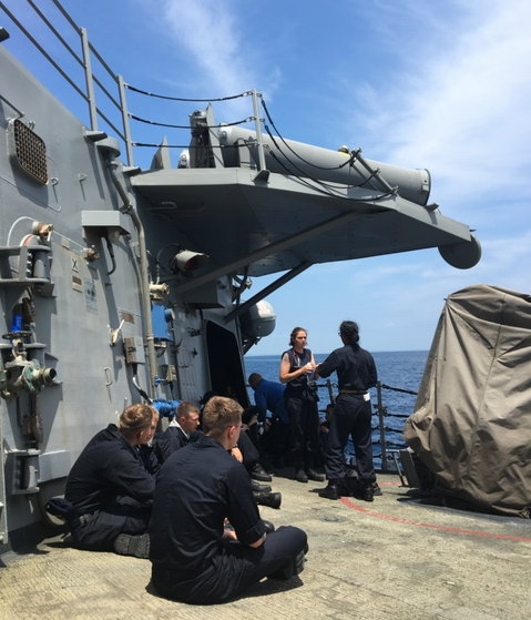 Sailors on the stricken warship Fitzgerald as it made its way back to land following a June 2017 collision that killed seven. (Photo provided to Navy Times)