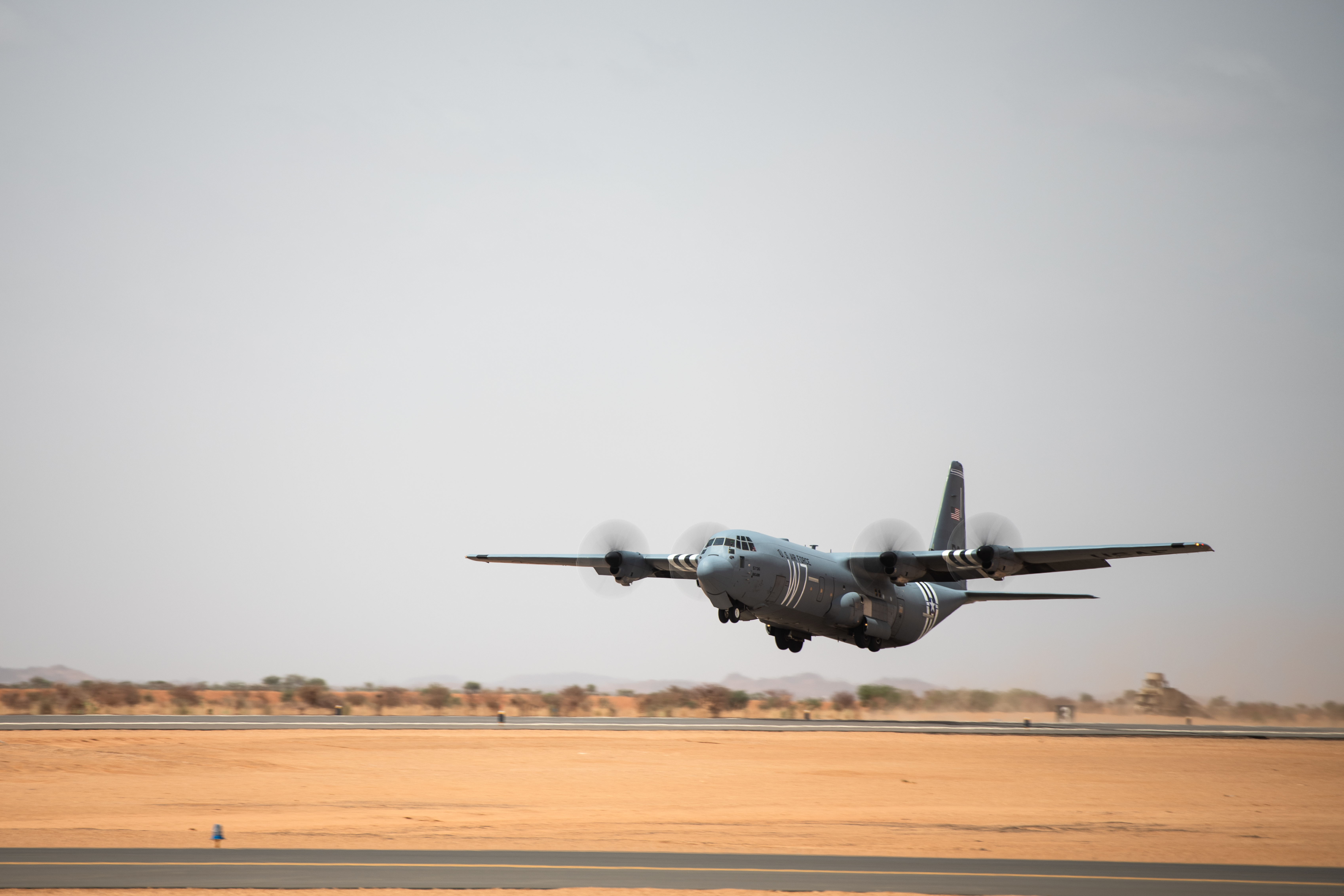 A C-130J Super Hercules lands at Air Base 201. The 6200-foot runway there allows any aircraft up to a C-17 Globemaster III to land. (Staff Sgt. Devin Boyer/Air Force)