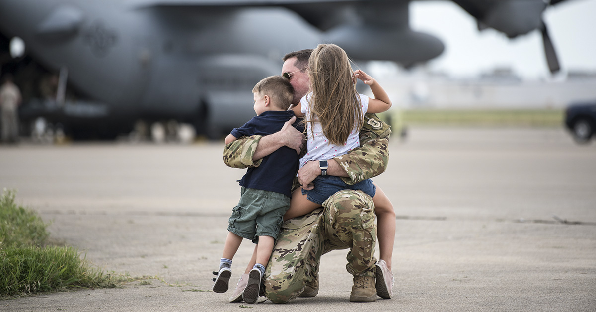 More than 60 members of the Kentucky Air National GuardÕs 123rd Airlift Wing are reunited with friends and family as they return to their home base in Louisville, Ky., July 6, 2018, after completing a four-month deployment to the Persian Gulf region in support of Operation Inherent Resolve. (Master Sgt. Phil Speck/Air National Guard)