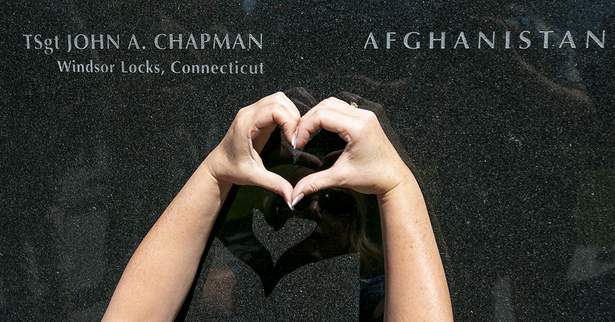Family friend makes a heart next to the engraving for Technical Sgt. John Chapman, after his name was unveiled during a Medal of Honor ceremony at the Air Force Memorial Friday August 24, 2018. Chapman, was awarded the Medal of Honor Wednesday, for actions during a battle atop Takur Ghar mountain in Afghanistan on March 4, 2002. (Alan Lessig/Staff)